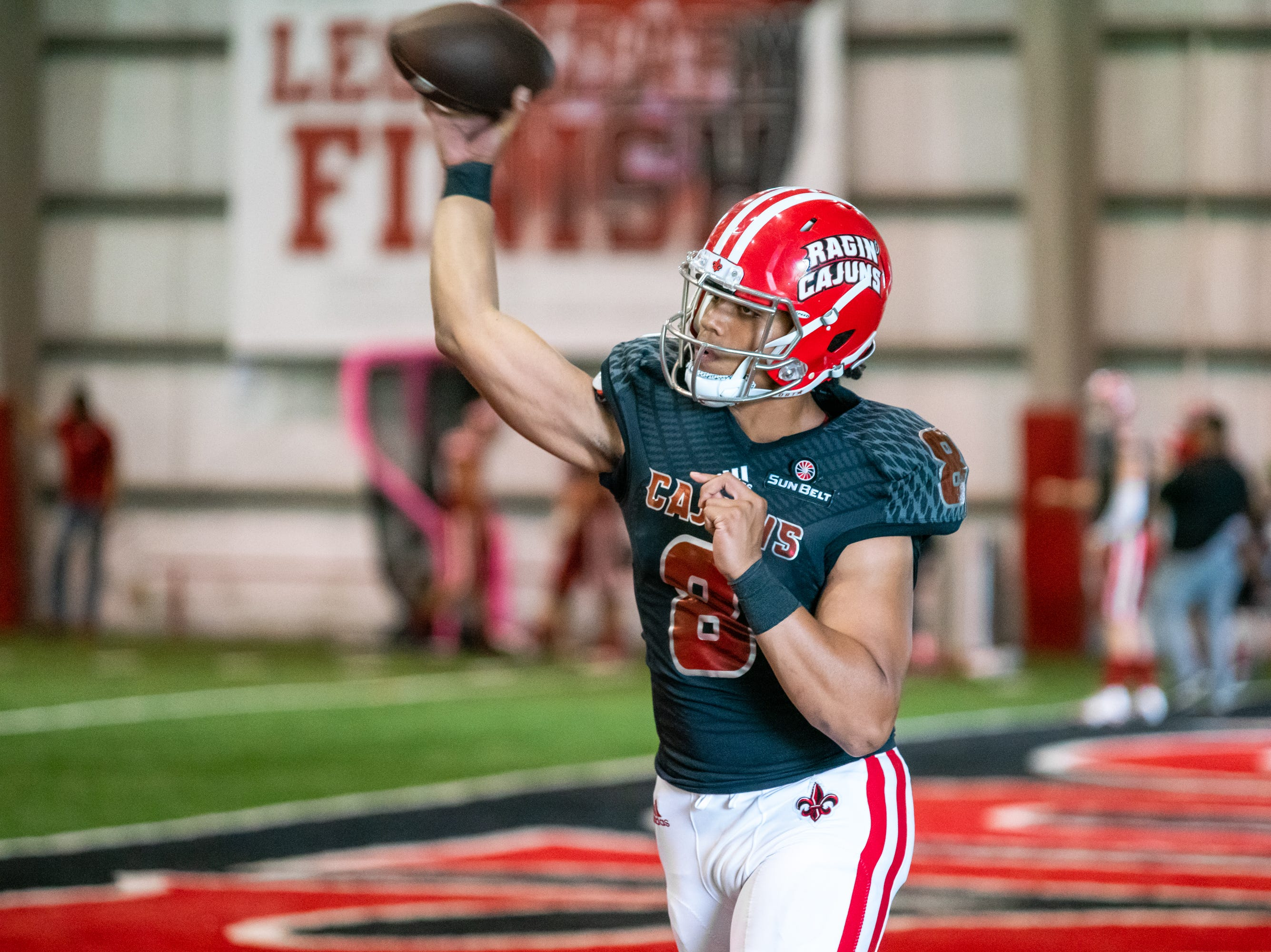 UL's quarterback Jai'ave Magalei practices his throw during halftime as the Ragin' Cajuns football team plays their annual Spring football game against one another in the Leon Moncla trainig facility on April 13, 2019.