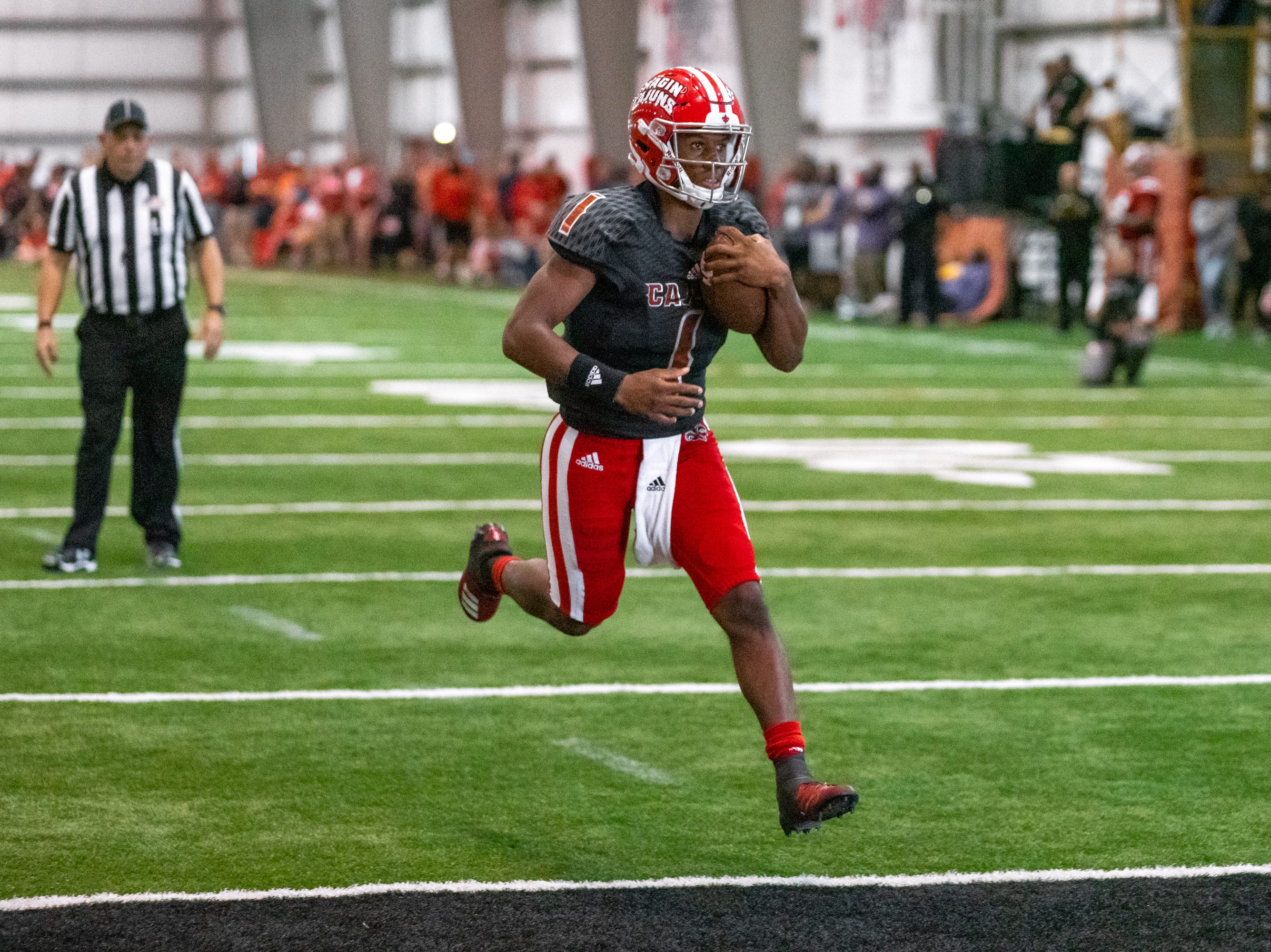 UL's quarterback Levi Lewis carries the ball to score a touchdown as the Ragin' Cajuns football team plays their annual Spring football game against one another in the Leon Moncla trainig facility on April 13, 2019.