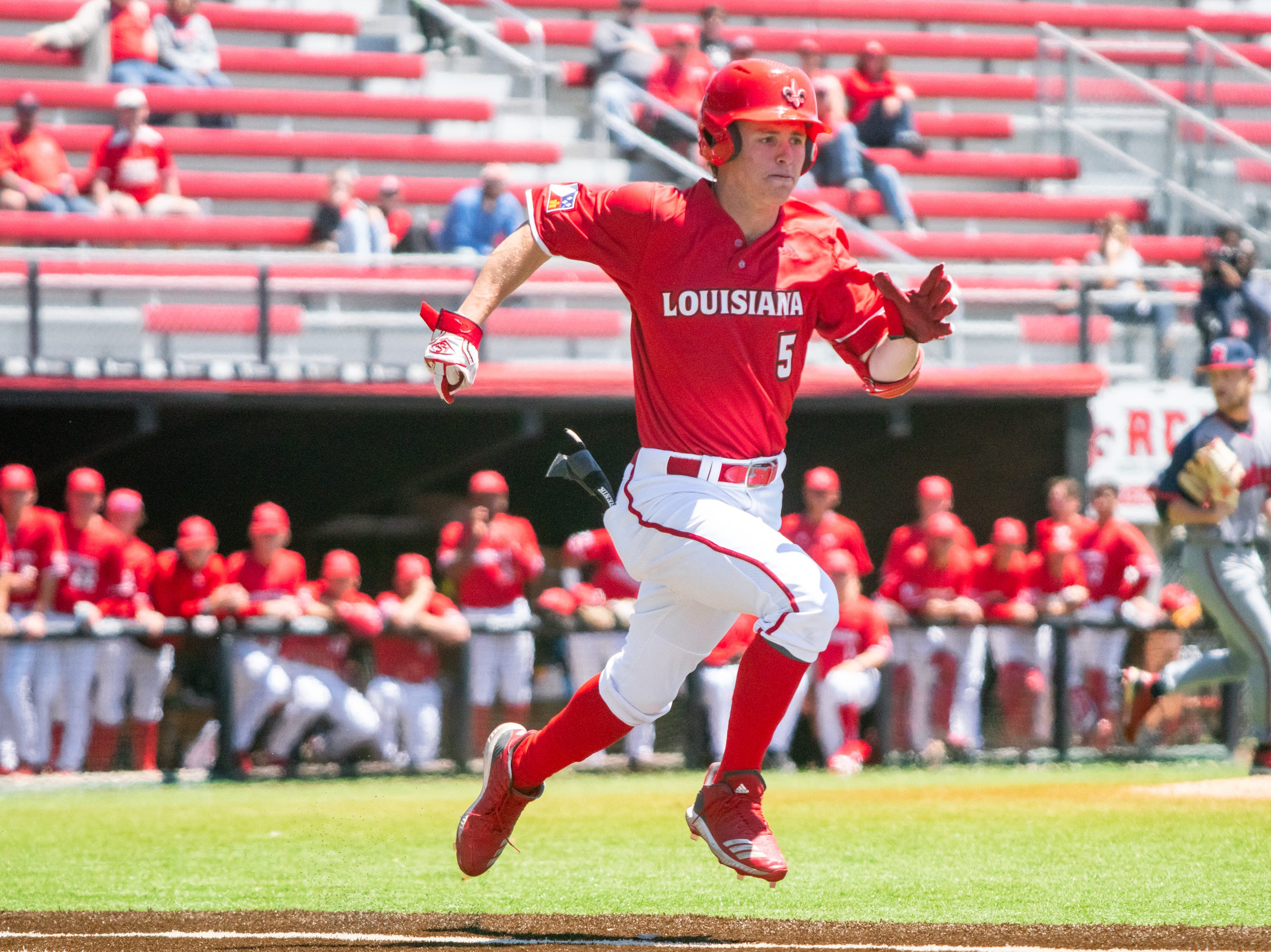 """UL's Hayden Cantrelle sprints to first base as the Ragin' Cajuns take on the South Alabama Jaguars at M.L. """"Tigue"""" Moore Field on Sunday, April 14, 2019."""