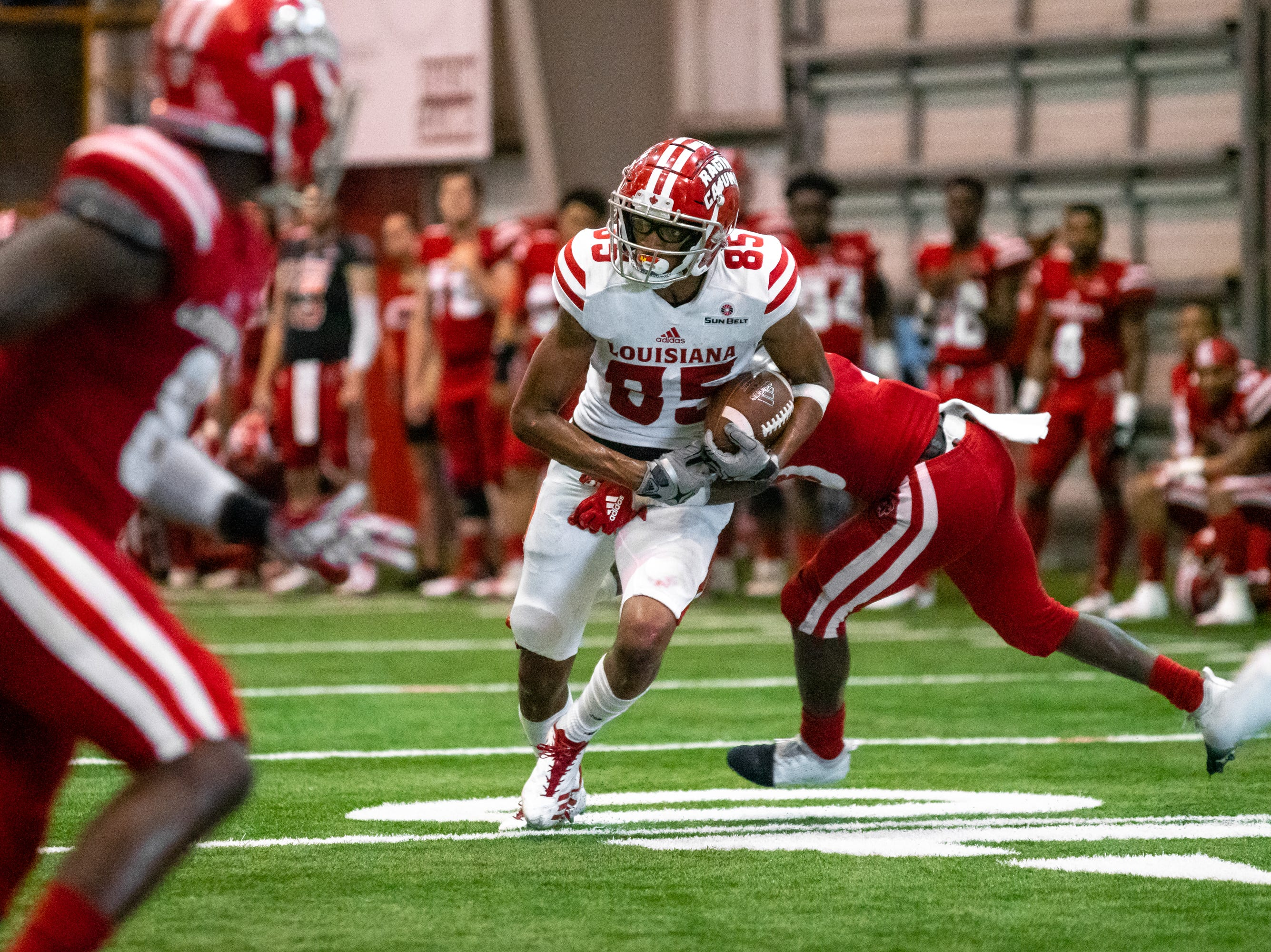 UL's Calif Gossett runs the ball down the field as the Ragin' Cajuns football team plays their annual Spring football game against one another in the Leon Moncla trainig facility on April 13, 2019.