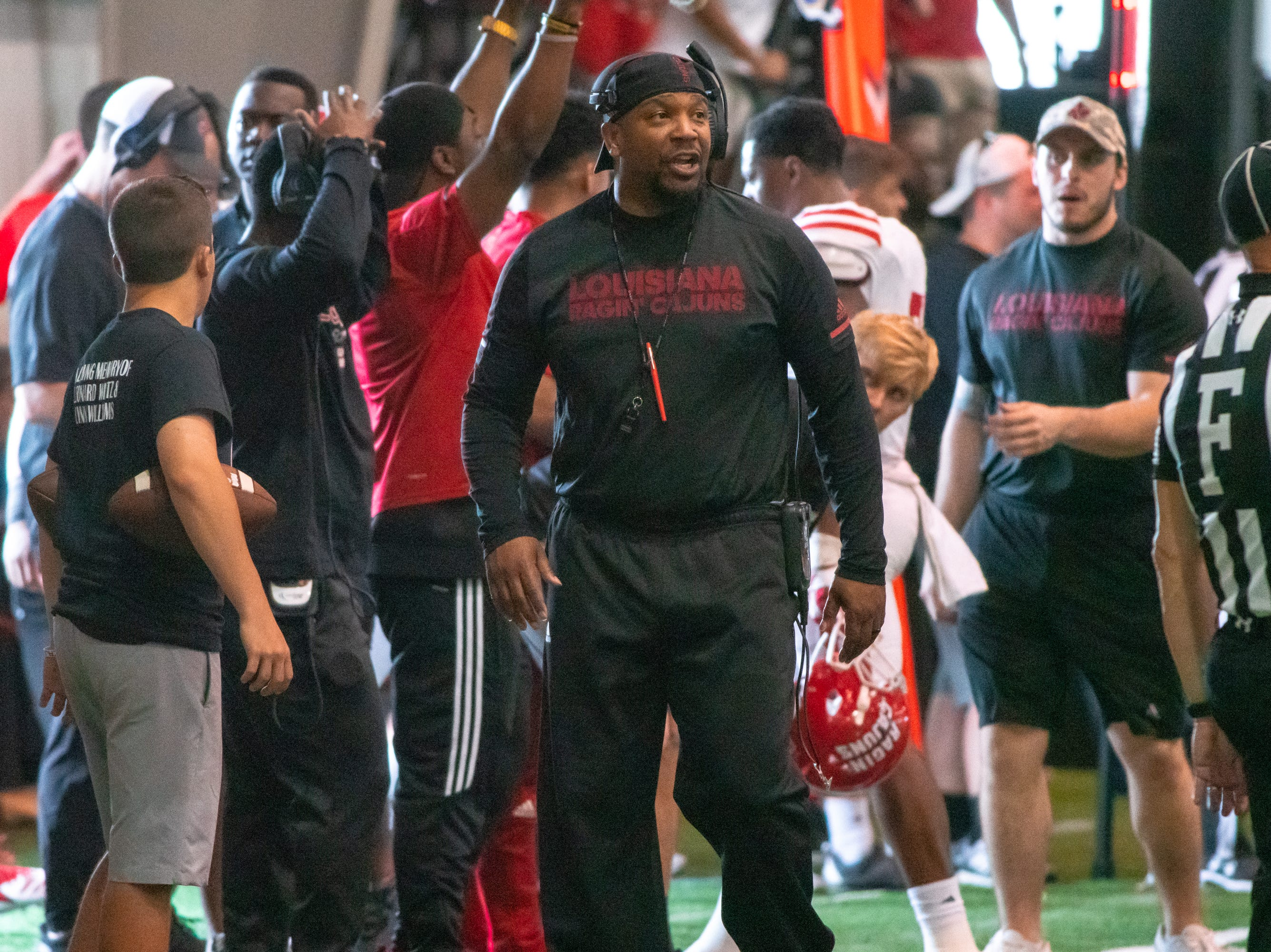 UL's assistant head coach Jabbar Juluke on the sidelines as the Ragin' Cajuns football team plays their annual Spring football game against one another in the Leon Moncla trainig facility on April 13, 2019.