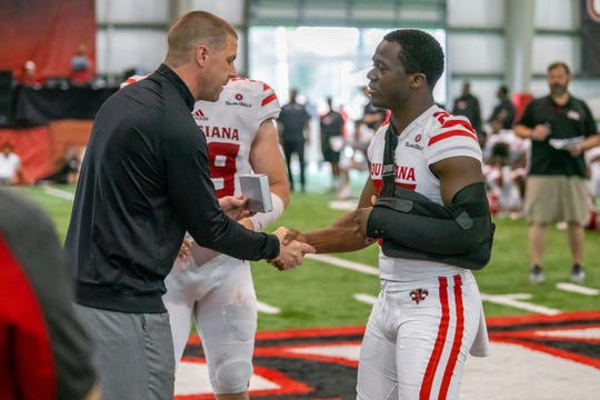 UL coach Billy Napier (left) makes a presentation to safety Deuce Wallace during the Ragin' Cajuns' spring game in April.