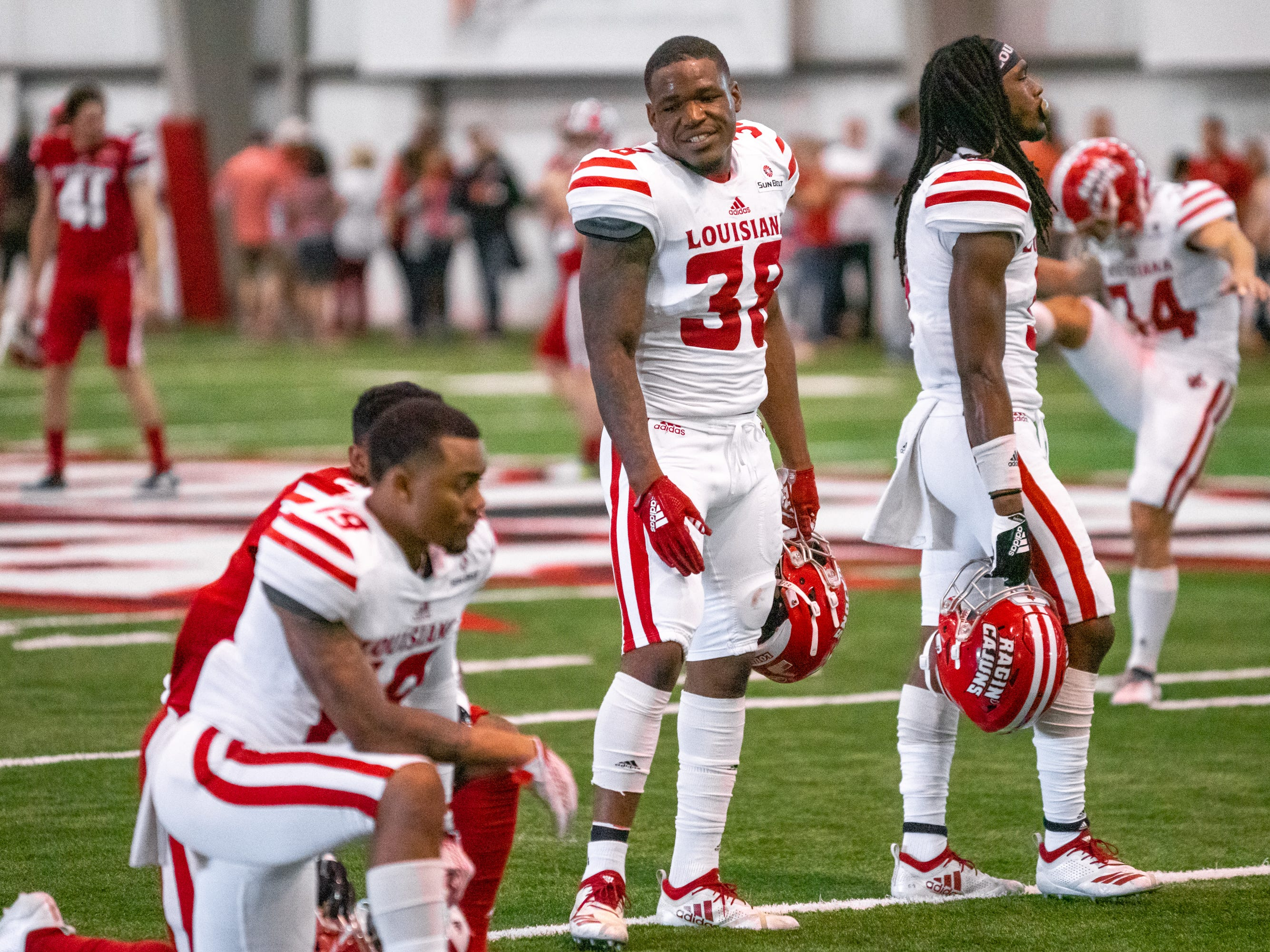 UL's Terik Miller talks to his teammates on the field as the Ragin' Cajuns football team plays their annual Spring football game against one another in the Leon Moncla trainig facility on April 13, 2019.