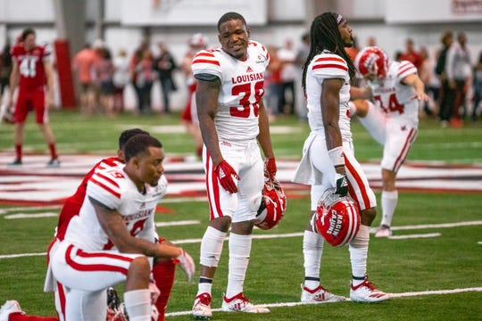 UL defensive back Terik Miller (38) talks with teammates during the Ragin' Cajuns' spring game in April.