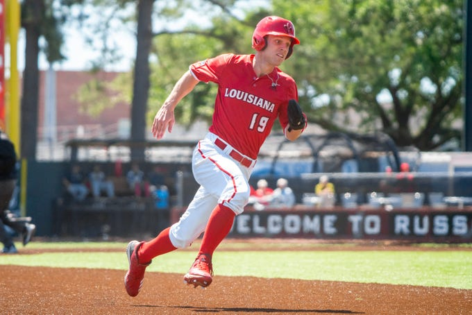 """UL's Hunter Kasuls sprints to thrid base as the Ragin' Cajuns take on the South Alabama Jaguars at M.L. """"Tigue"""" Moore Field on Sunday, April 14, 2019."""