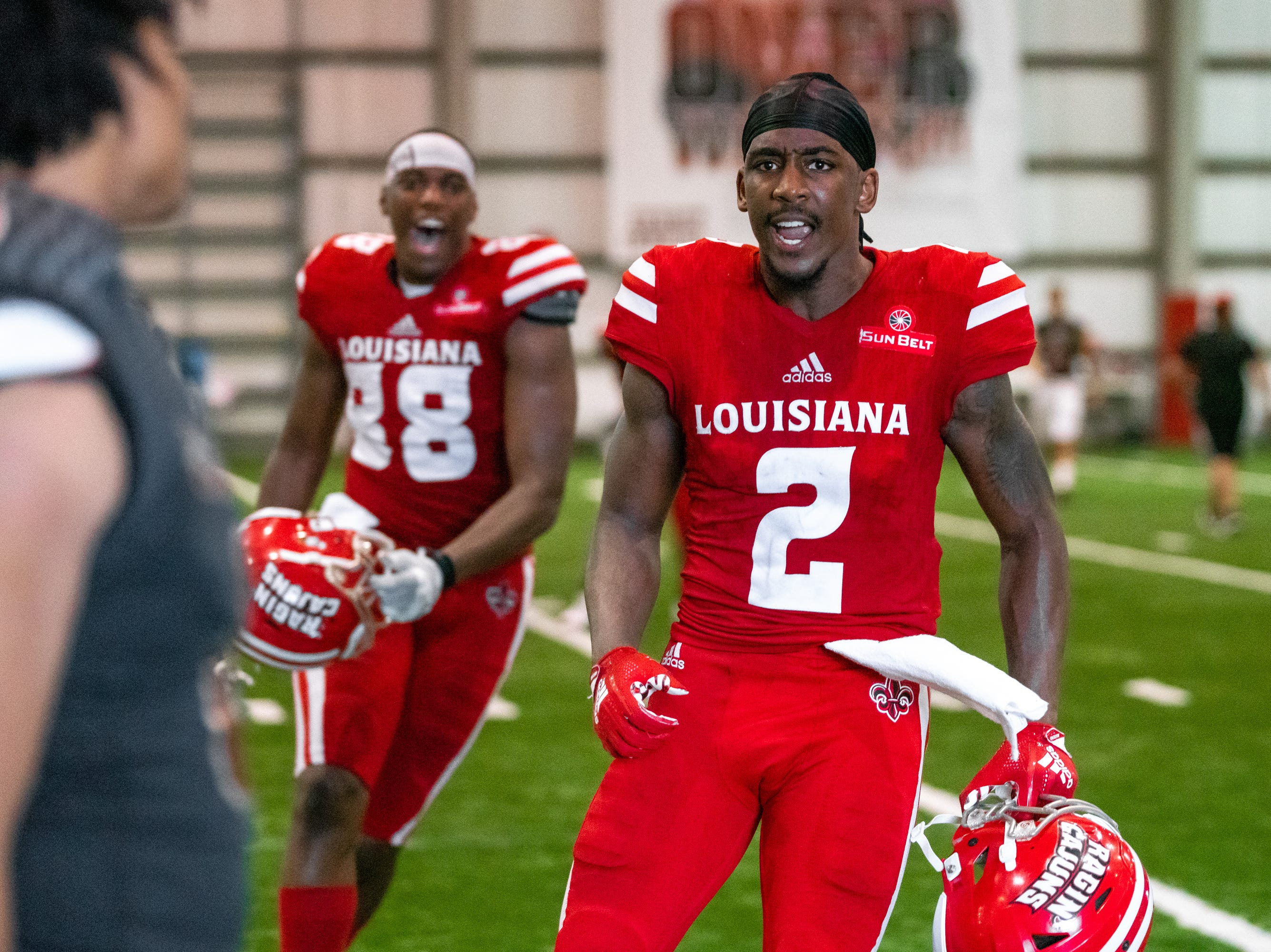 UL's Ja'Marcus Bradley celebrates the win after the game as the Ragin' Cajuns football team plays their annual Spring football game against one another in the Leon Moncla trainig facility on April 13, 2019.
