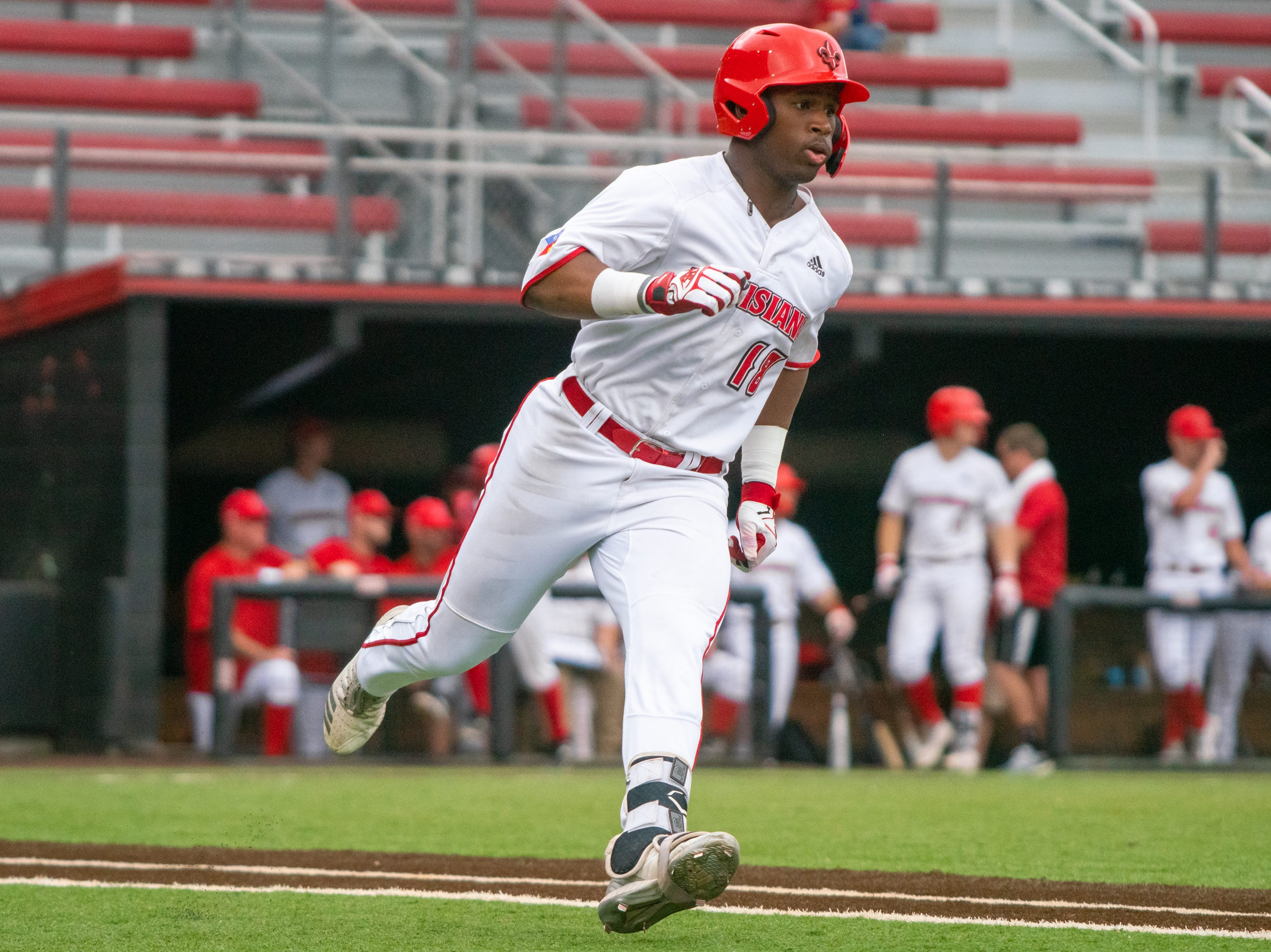 """UL's Tremaine Spears runs to first base as the Ragin' Cajuns take on the South Alabama Jaguars at M.L. """"Tigue"""" Moore Field on Saturday, April 13, 2019."""