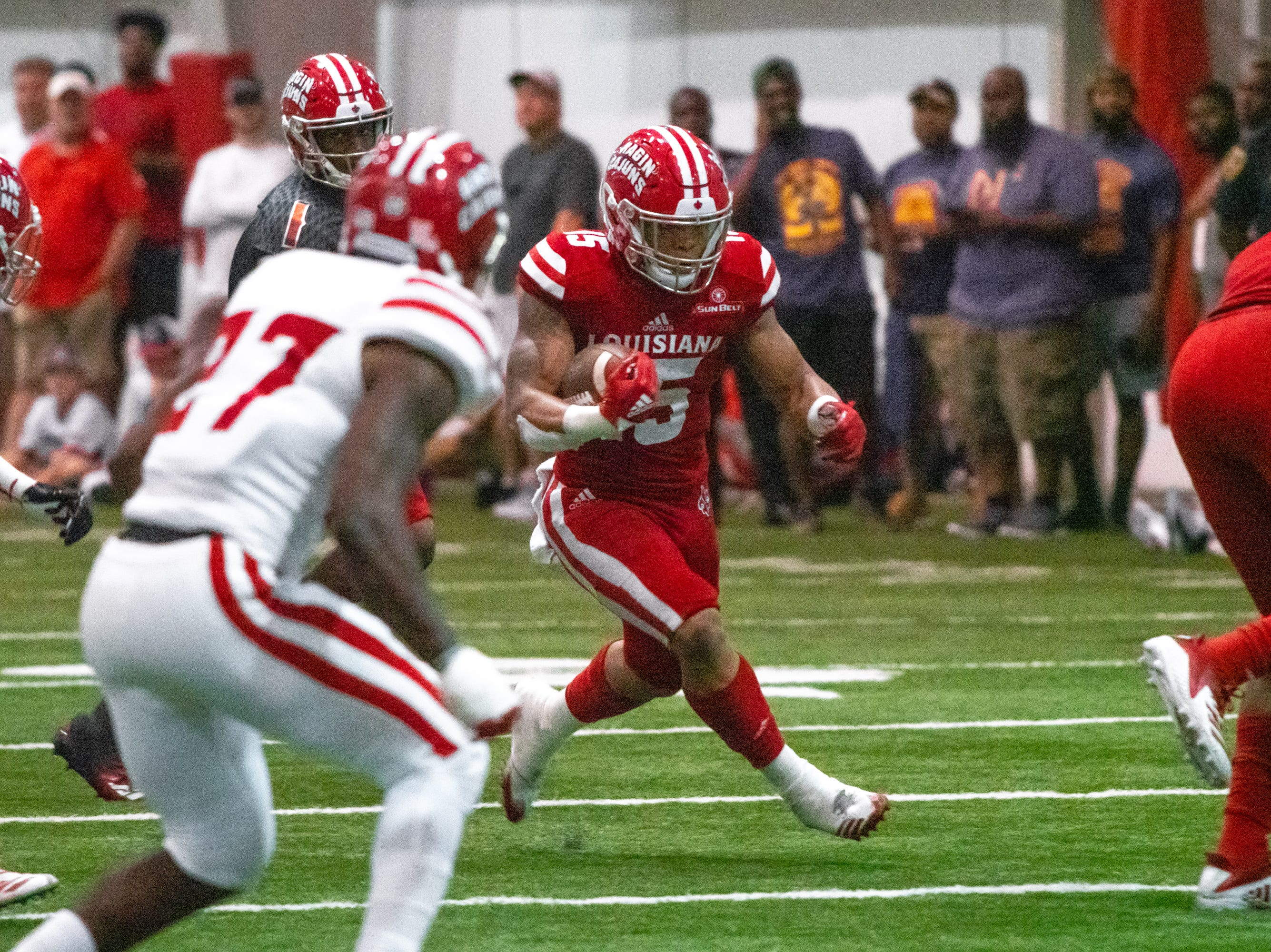 UL's Elijah Mitchell carries the ball during the play as the Ragin' Cajuns football team plays their annual Spring football game against one another in the Leon Moncla trainig facility on April 13, 2019.