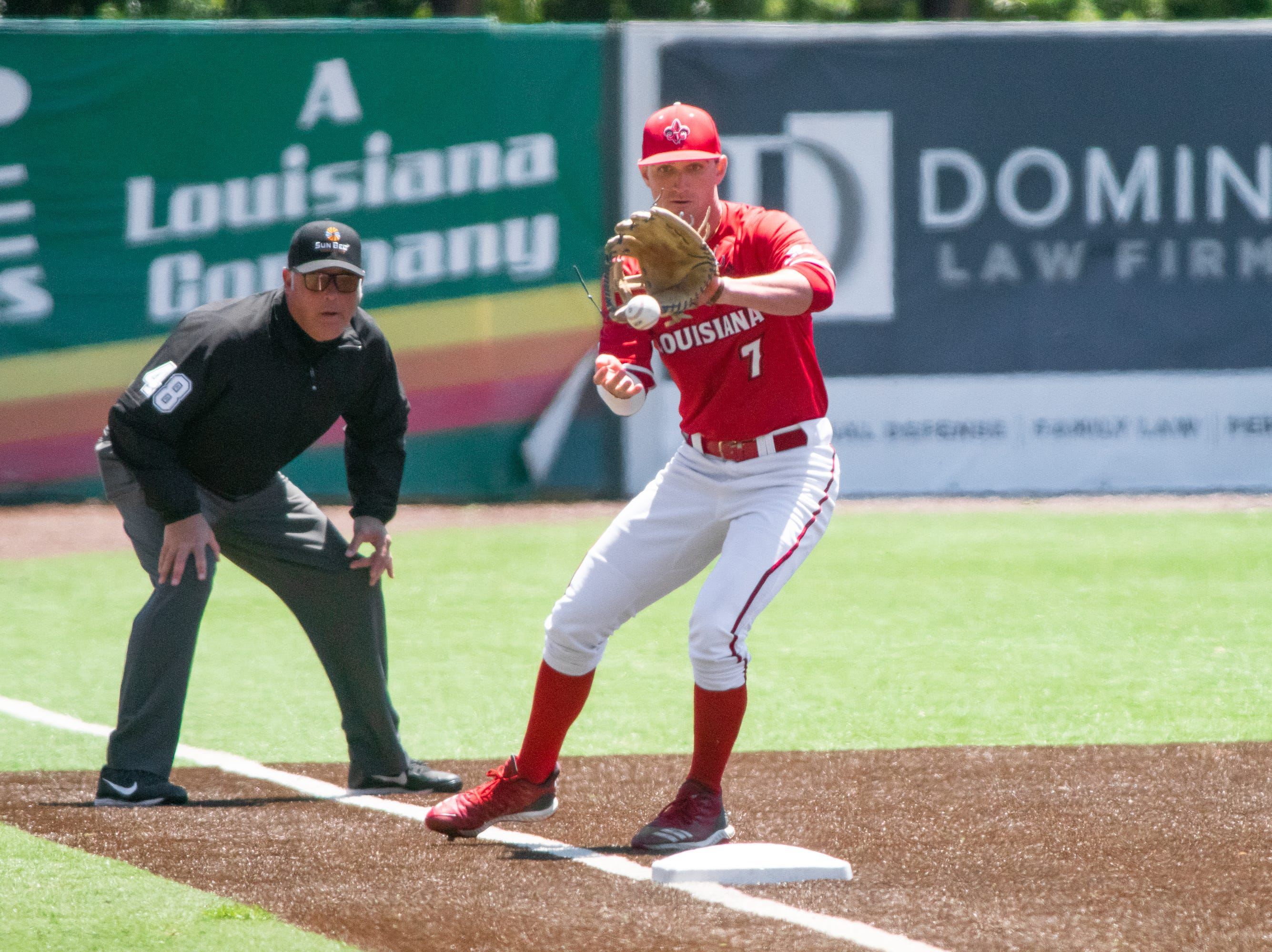 """UL's O'Neal Lochridge makes a catch at third base to throw to first as the Ragin' Cajuns take on the South Alabama Jaguars at M.L. """"Tigue"""" Moore Field on Sunday, April 14, 2019."""