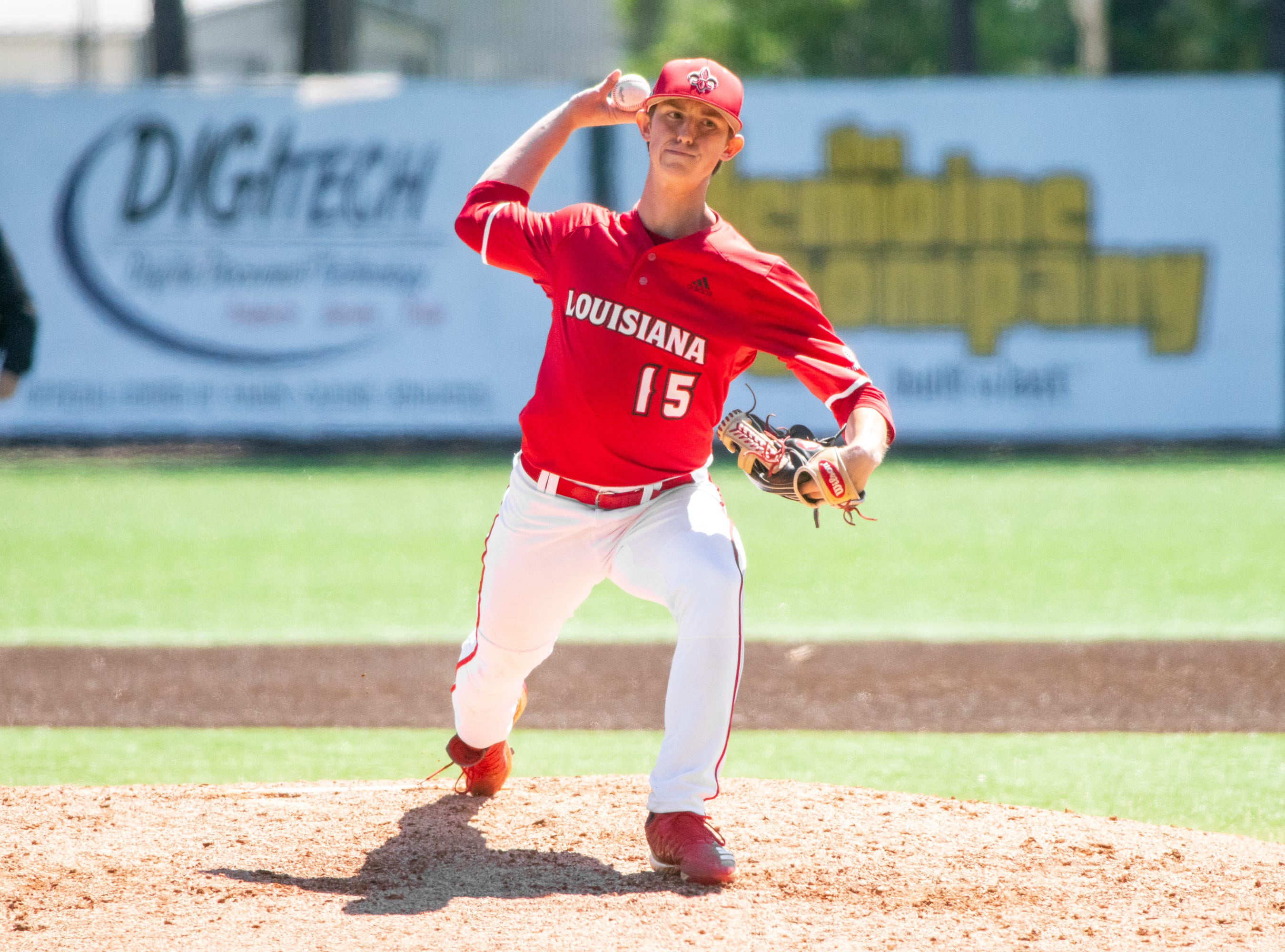 """UL's pitcher Jacob Schultz throws to the batter as the Ragin' Cajuns take on the South Alabama Jaguars at M.L. """"Tigue"""" Moore Field on Sunday, April 14, 2019."""