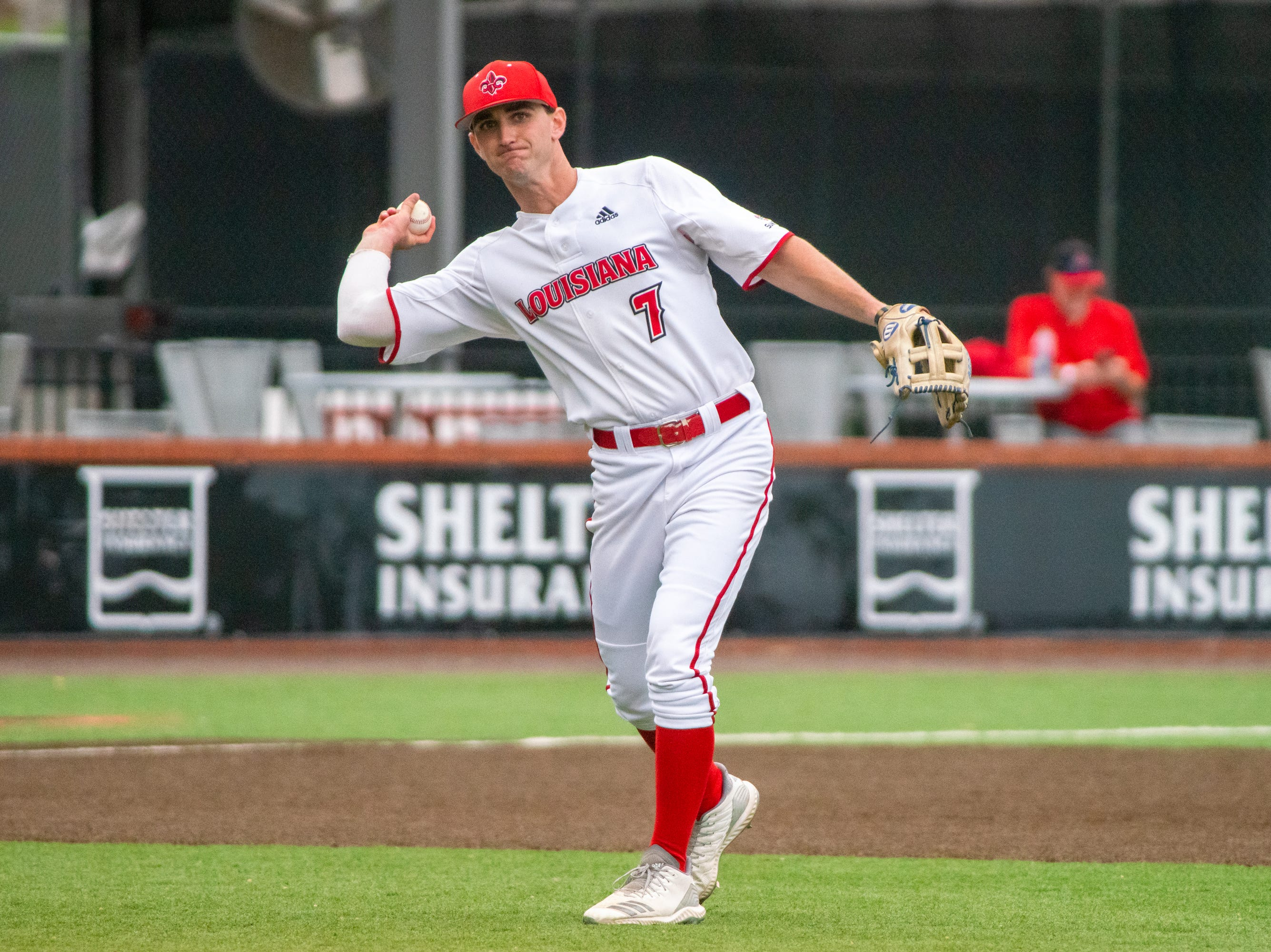 """UL's O'Neal Lochridge practices his throw in between innings as the Ragin' Cajuns take on the South Alabama Jaguars at M.L. """"Tigue"""" Moore Field on Saturday, April 13, 2019."""
