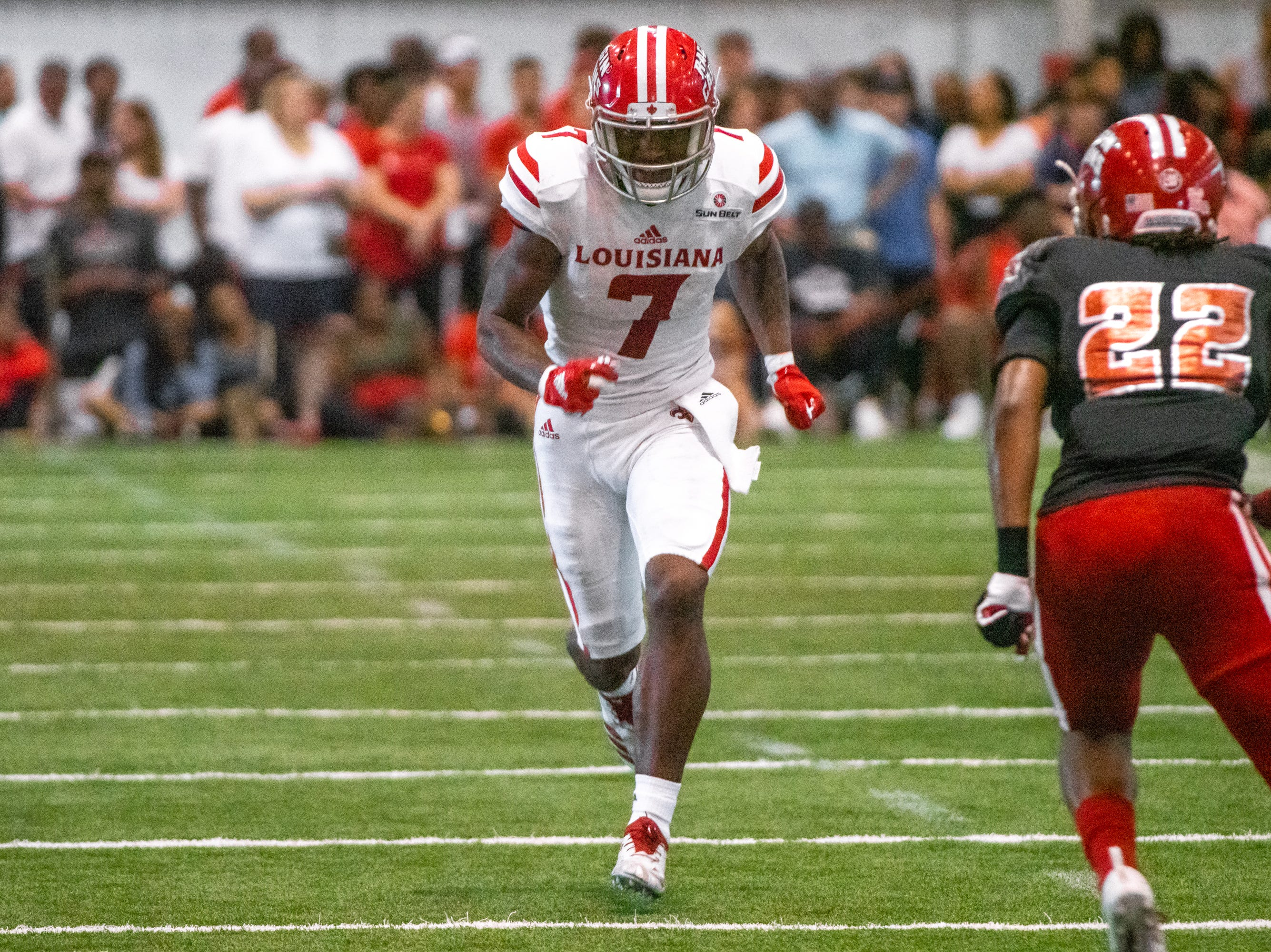 UL's Brian Smith rushes rushes down the field during the play as the Ragin' Cajuns football team plays their annual Spring football game against one another in the Leon Moncla trainig facility on April 13, 2019.