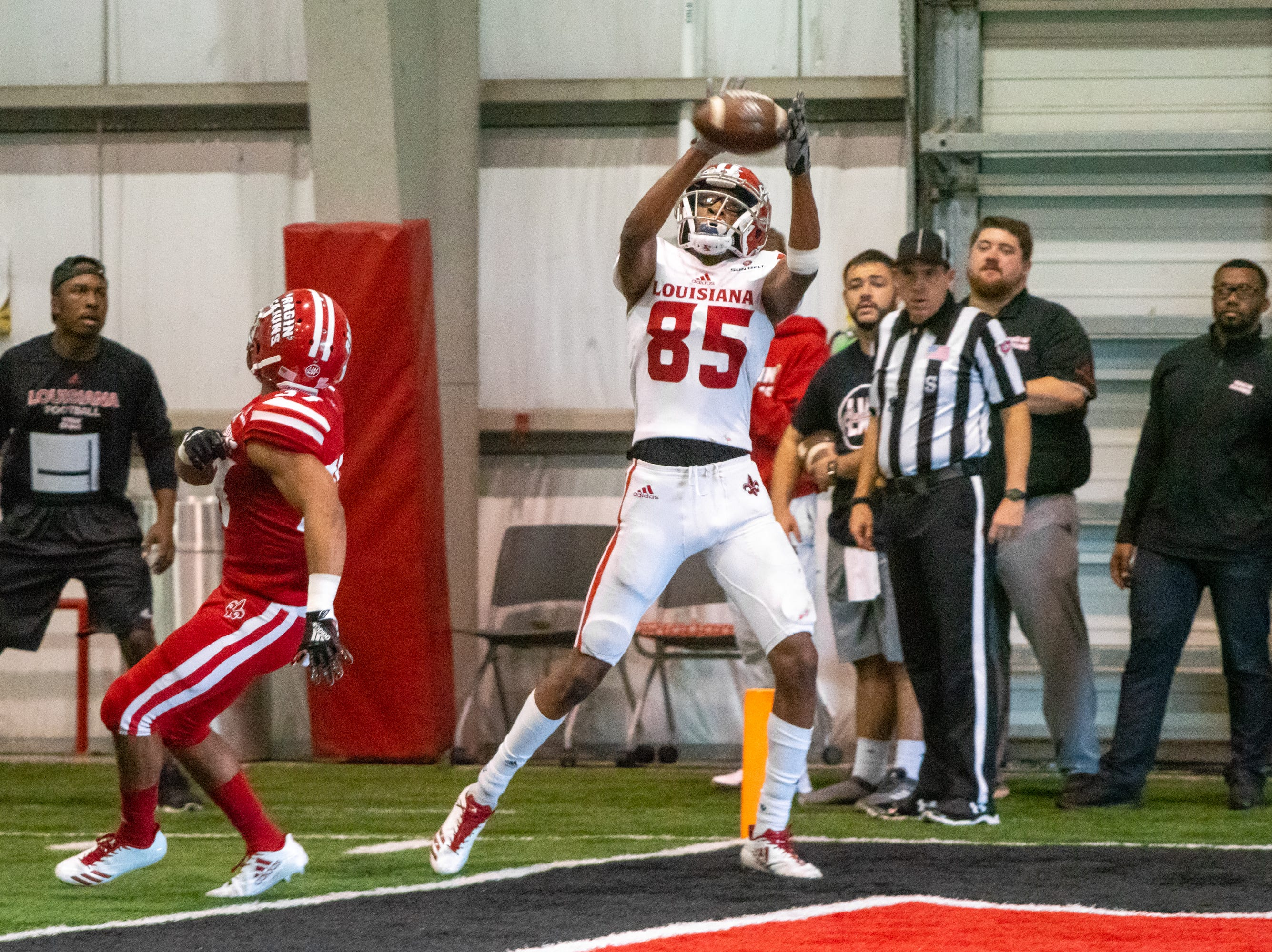 UL's Calif Gossett makes a catch in the endzone to score as the Ragin' Cajuns football team plays their annual Spring football game against one another in the Leon Moncla trainig facility on April 13, 2019.