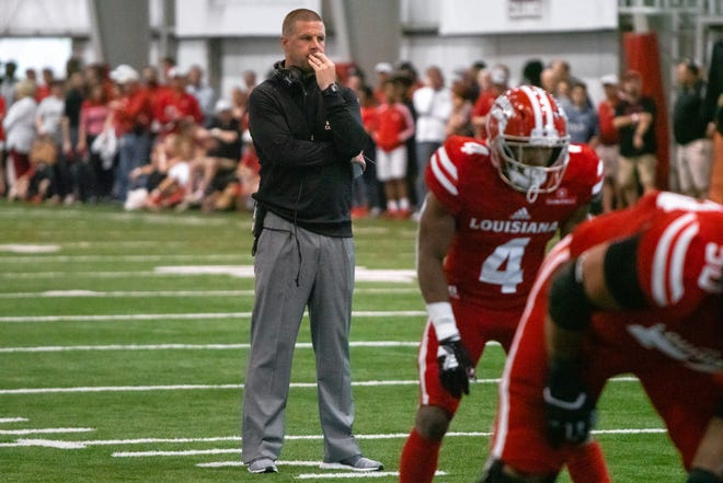 UL's head coach Billy Napier watches his players perform on the field as the Ragin' Cajuns football team plays their annual Spring football game against one another in the Leon Moncla trainig facility on April 13, 2019.