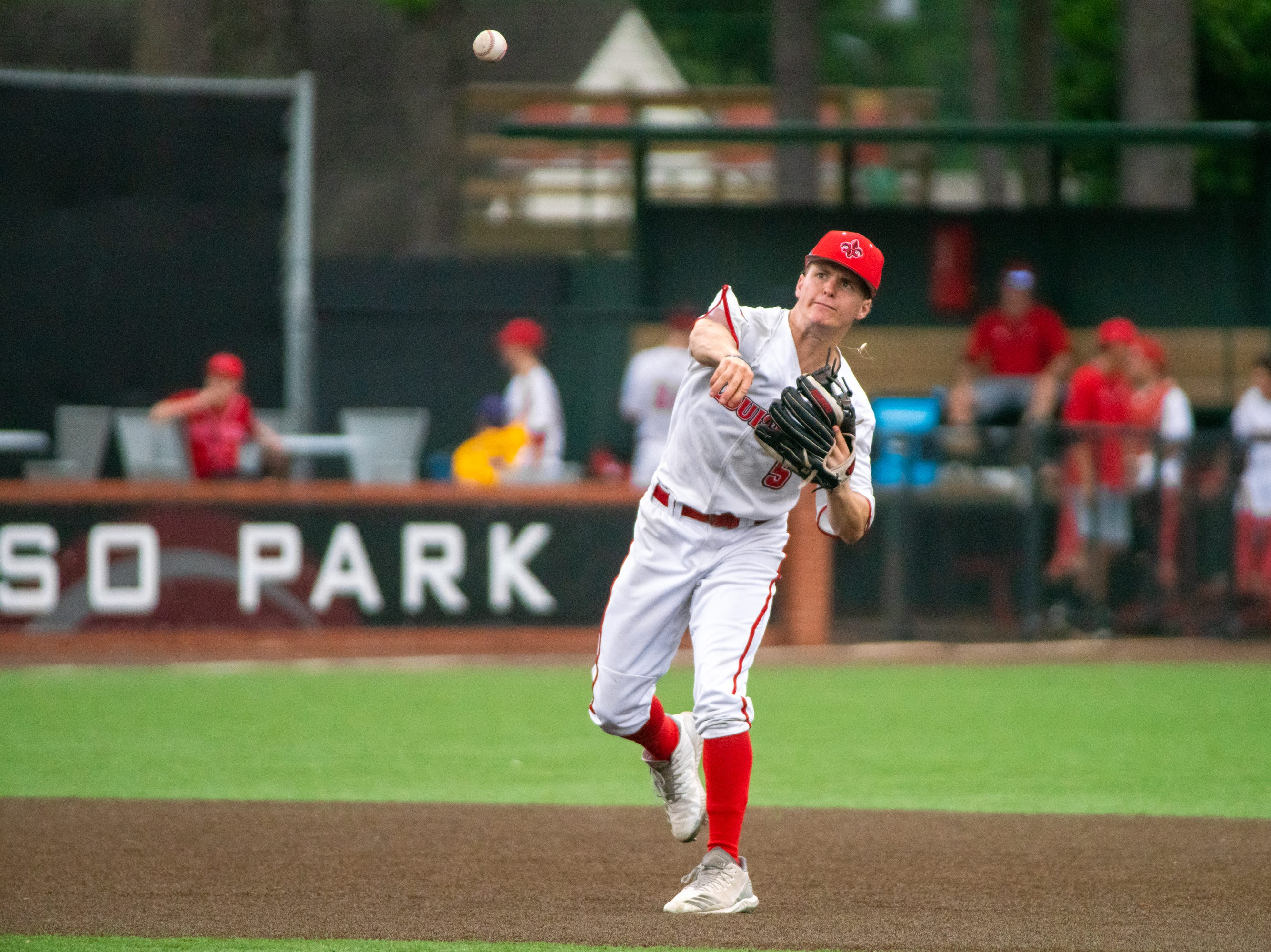 """UL's Hayden Cantrelle throws the ball to first base as the Ragin' Cajuns take on the South Alabama Jaguars at M.L. """"Tigue"""" Moore Field on Saturday, April 13, 2019."""