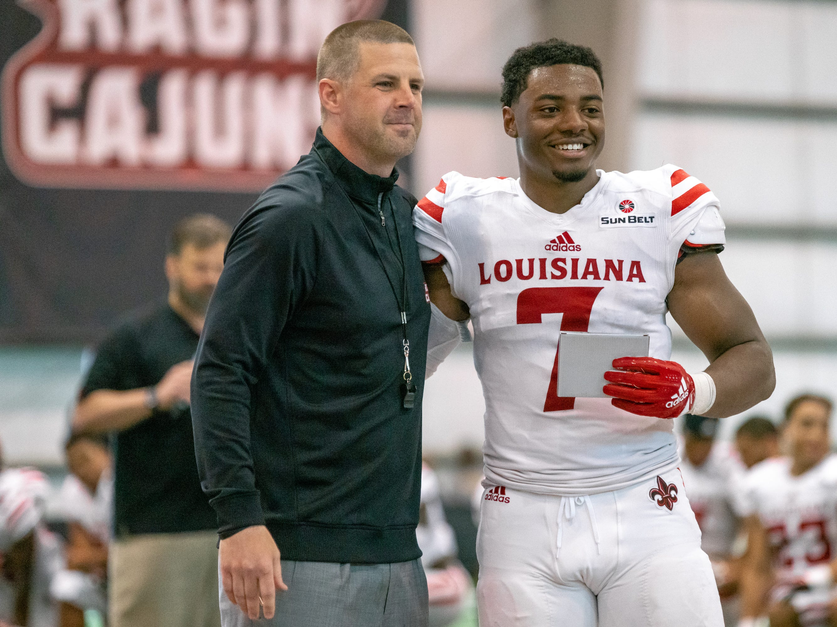 UL's Ferrod Gardner with head coach Billy Napier during halftime as the Ragin' Cajuns football team plays their annual Spring football game against one another in the Leon Moncla trainig facility on April 13, 2019.