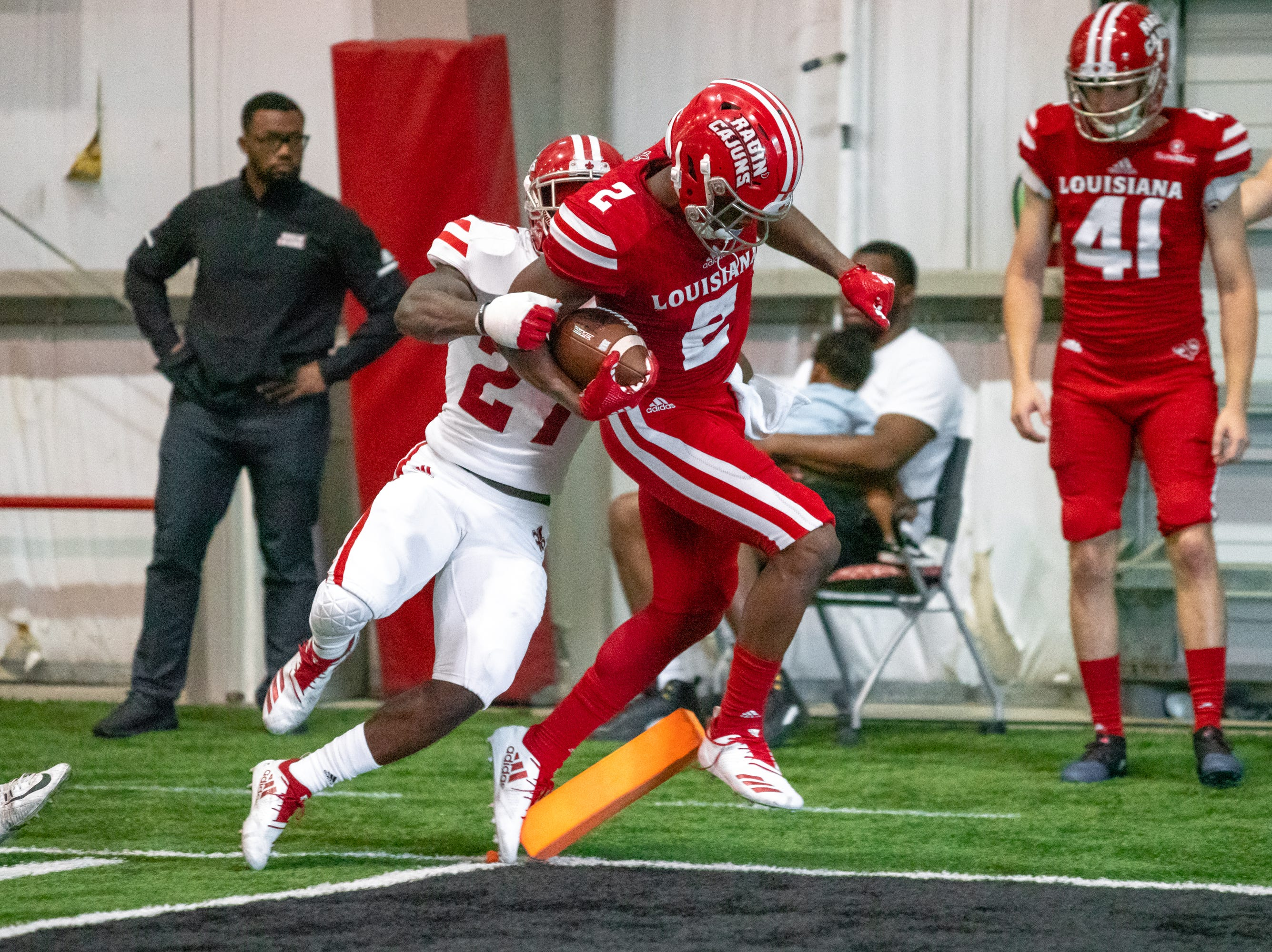 UL's Ja'Marcus Bradley steps out of bounds before running the ball into the endzone as the Ragin' Cajuns football team plays their annual Spring football game against one another in the Leon Moncla trainig facility on April 13, 2019.