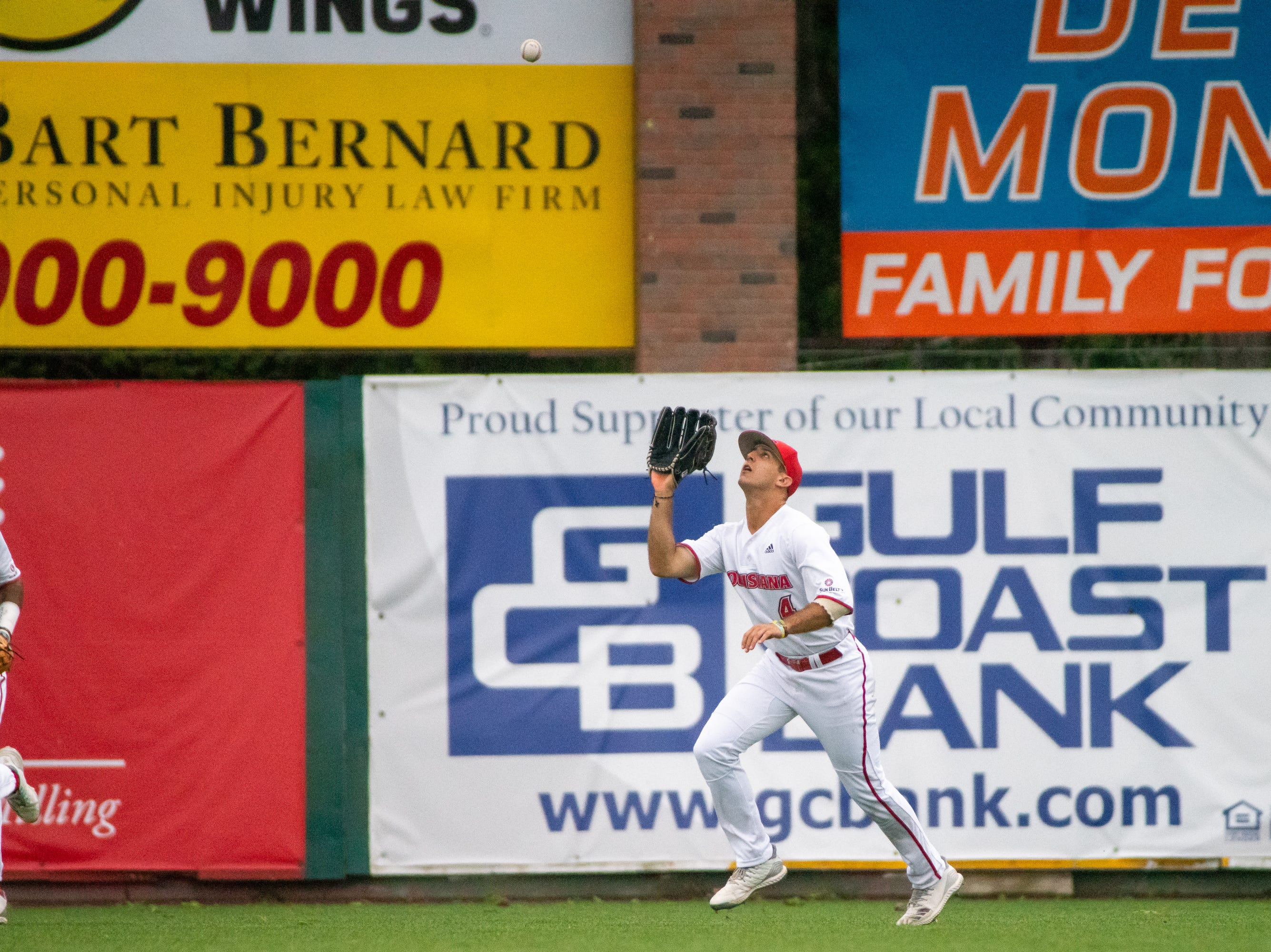 """UL's Brennan Breaux catches a flyball in the outfield as the Ragin' Cajuns take on the South Alabama Jaguars at M.L. """"Tigue"""" Moore Field on Saturday, April 13, 2019."""