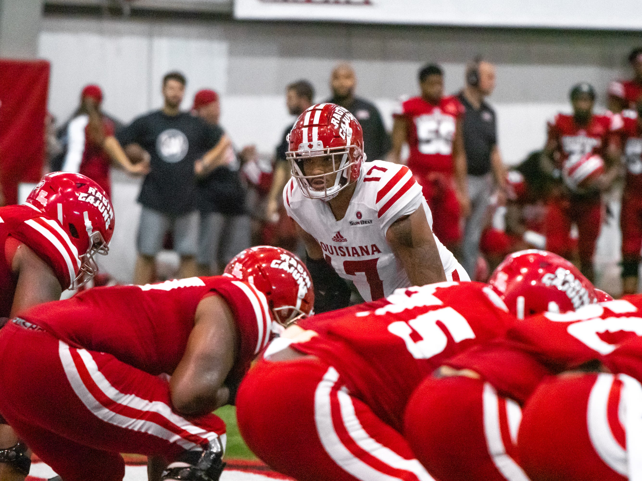 UL's Chauncey Manac looks over the offensive line as the Ragin' Cajuns football team plays their annual Spring football game against one another in the Leon Moncla trainig facility on April 13, 2019.