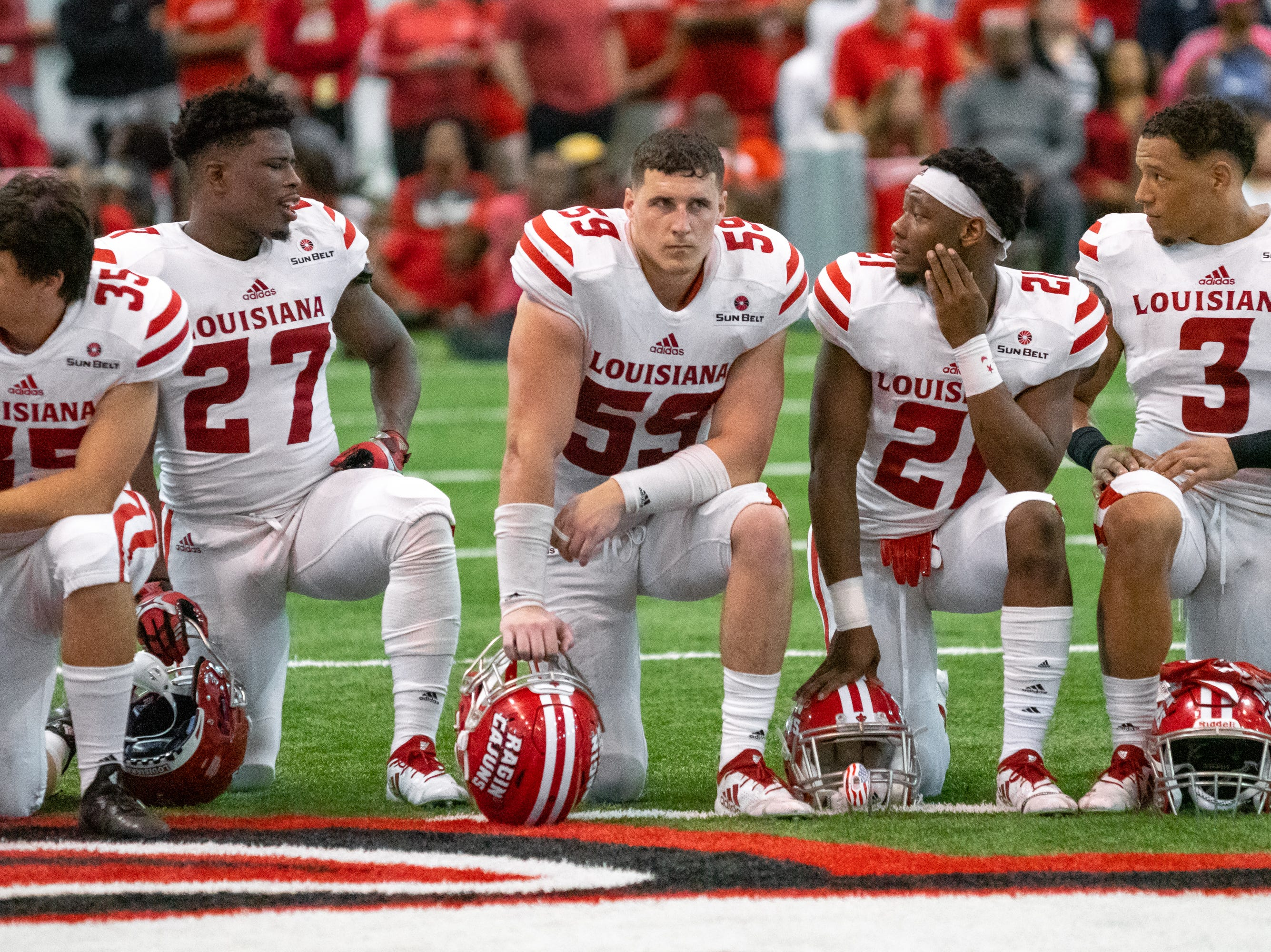 UL's Jacques Boudreaux (59)  kneels on the field during halftime as the Ragin' Cajuns football team plays their annual Spring football game against one another in the Leon Moncla trainig facility on April 13, 2019.