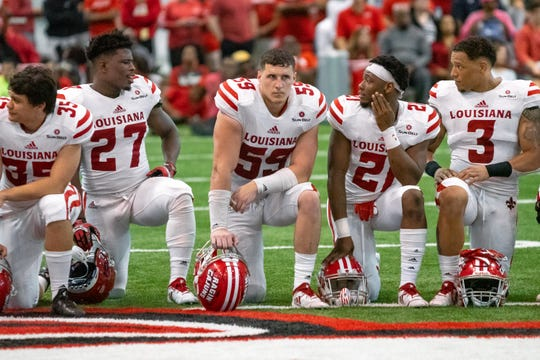UL's Jacques Boudreaux (59) kneels on the field during halftime as the Ragin' Cajuns play their annual Spring football game in April. Boudreaux took a big leap last year after appearing in all 12 games as a sophomore in 2017.
