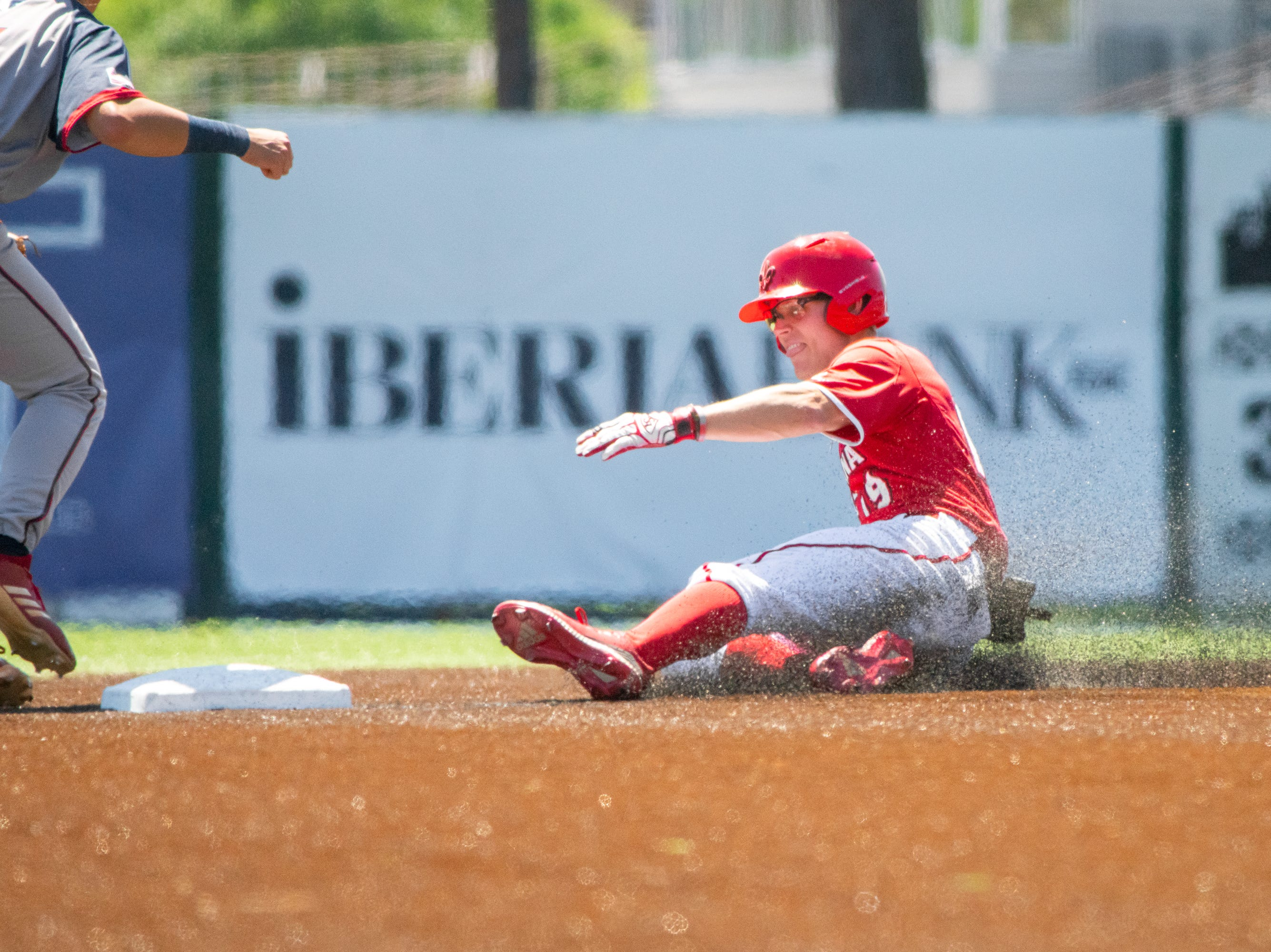 "UL's Hunter Kasuls slides safe onto second base as the Ragin' Cajuns take on the South Alabama Jaguars at M.L. ""Tigue"" Moore Field on Sunday, April 14, 2019."