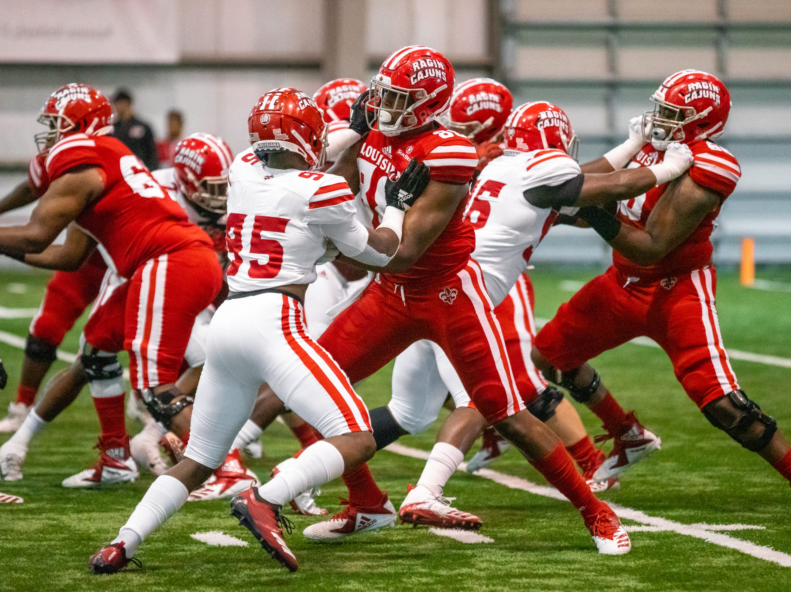 UL's lineman battle with one another on the field as the Ragin' Cajuns football team plays their annual Spring football game against one another in the Leon Moncla trainig facility on April 13, 2019.