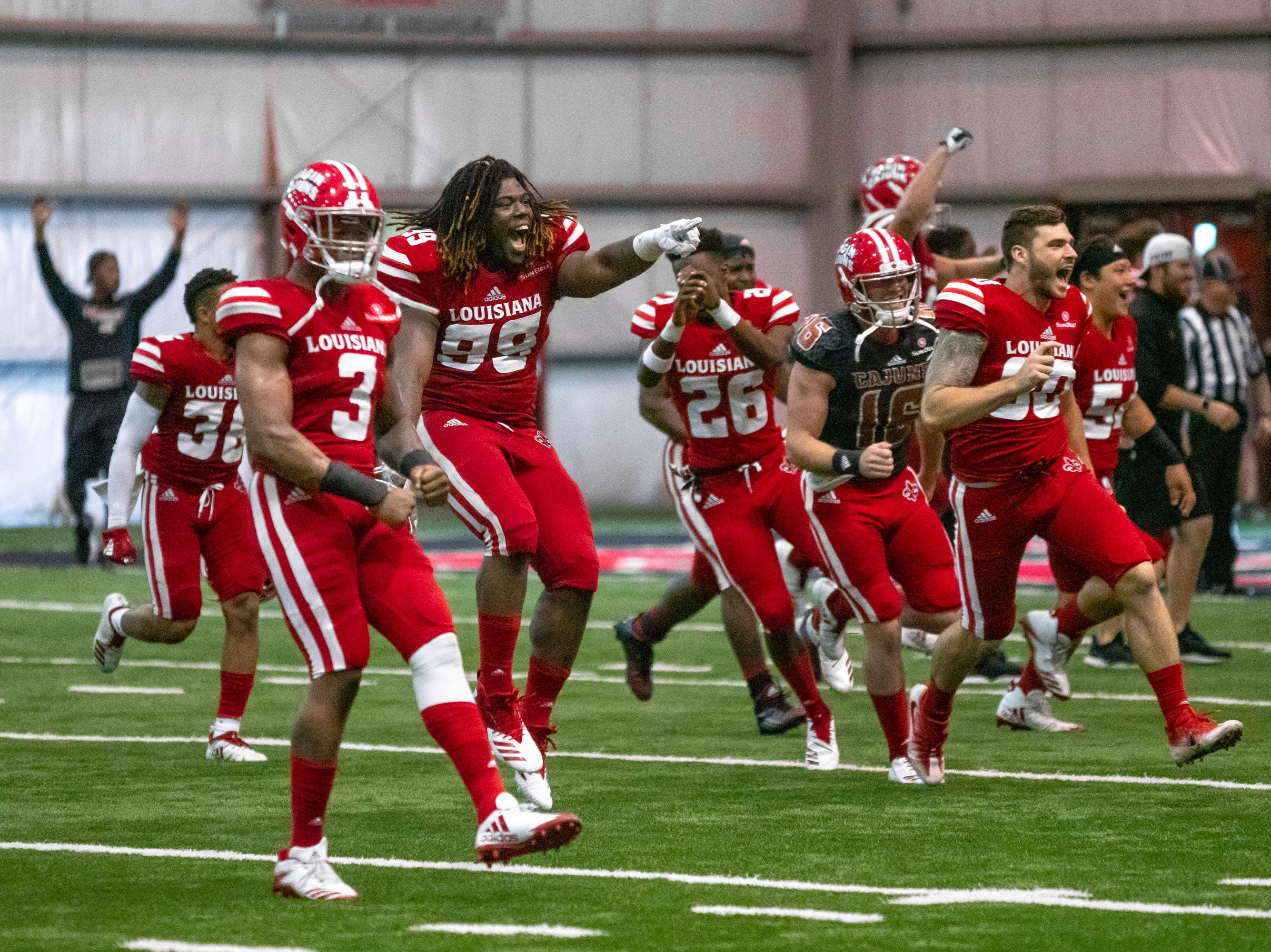 UL's Vermilion team celebrates their win after the game as the Ragin' Cajuns football team plays their annual Spring football game against one another in the Leon Moncla trainig facility on April 13, 2019.