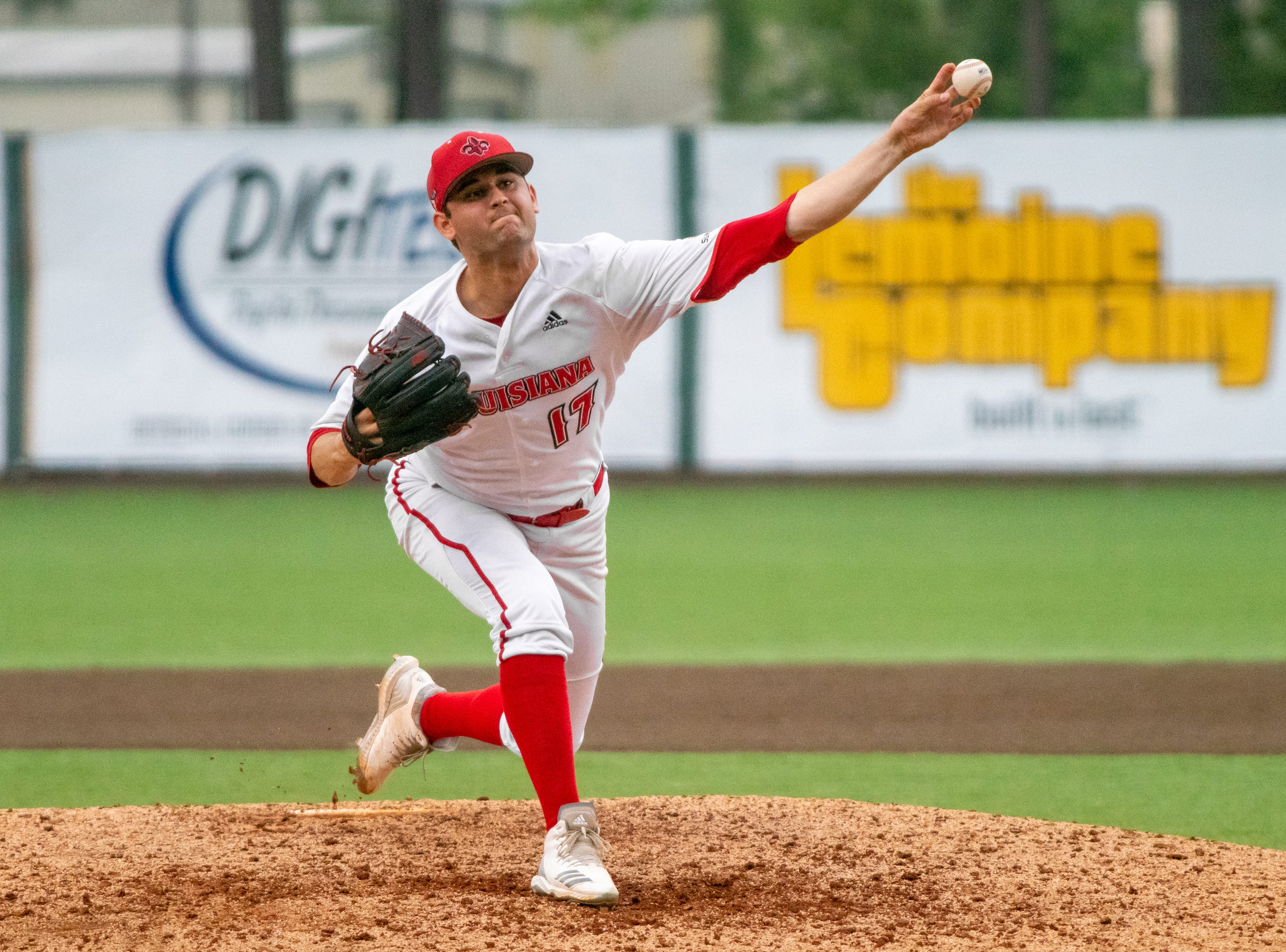 """UL's pitcher Gunner Leger throws the ball to the batter as the Ragin' Cajuns take on the South Alabama Jaguars at M.L. """"Tigue"""" Moore Field on Saturday, April 13, 2019."""