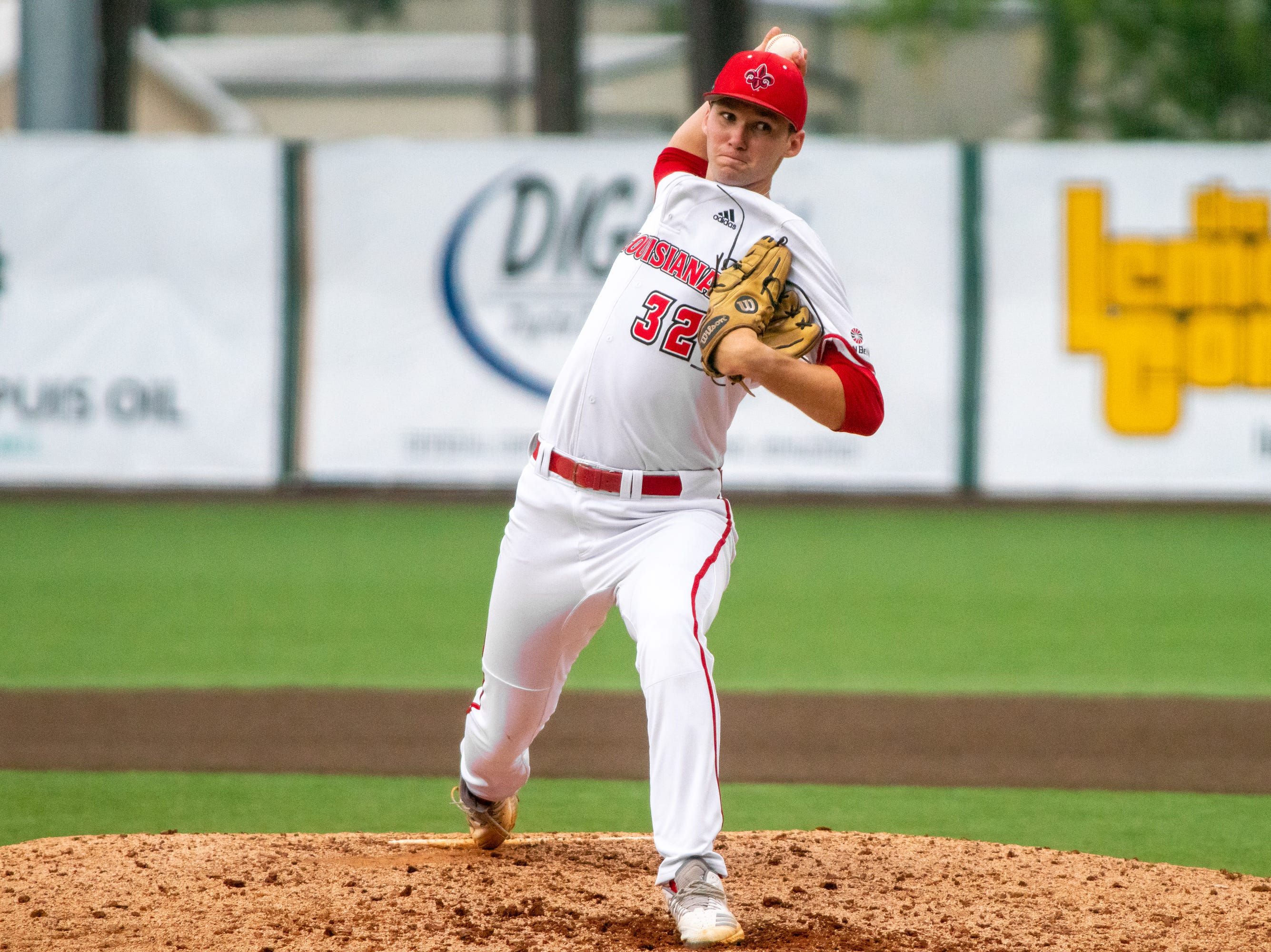 """UL's Brandon Young winds up a throw to the batter as the Ragin' Cajuns take on the South Alabama Jaguars at M.L. """"Tigue"""" Moore Field on Saturday, April 13, 2019."""