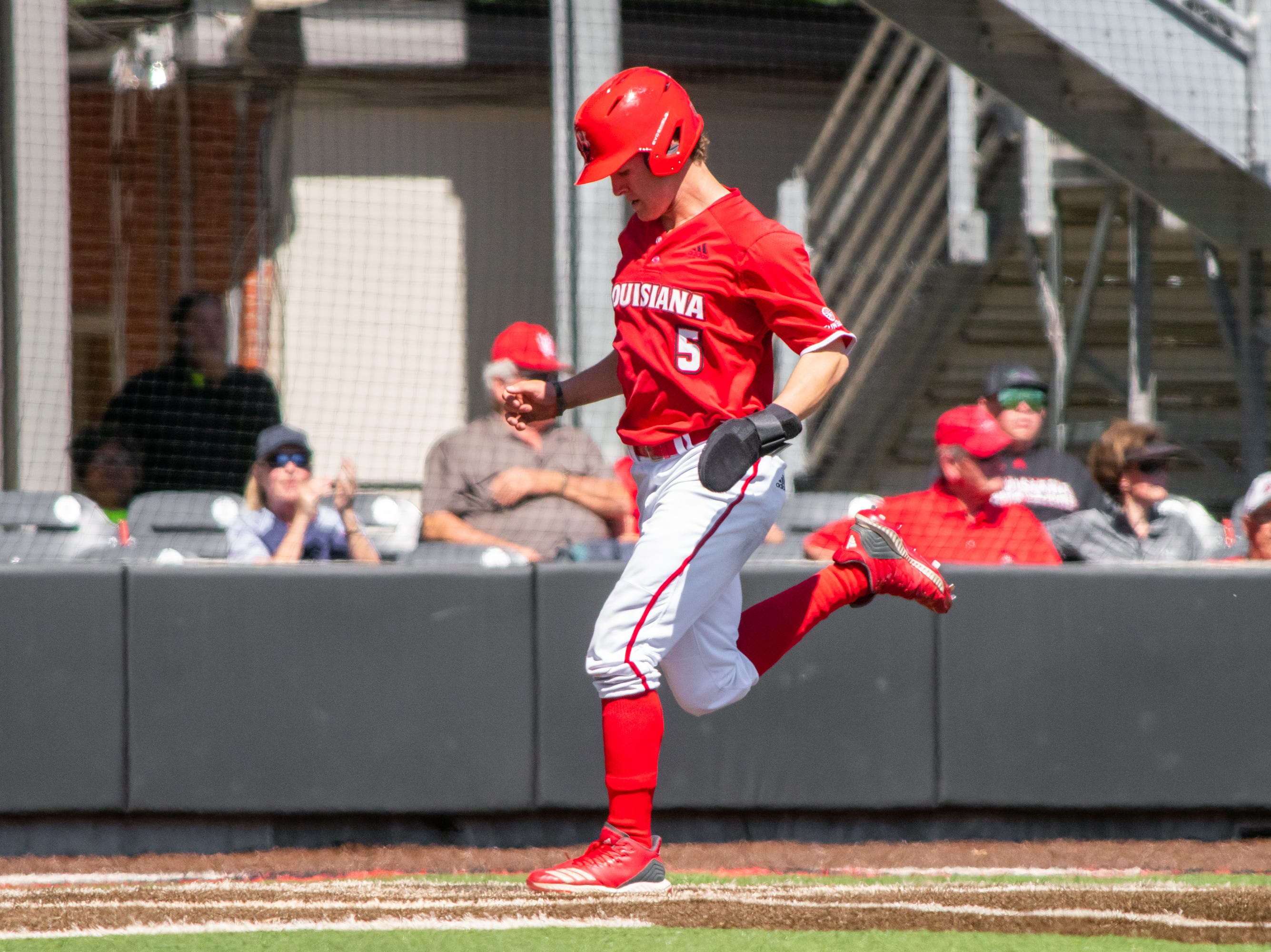 """UL's Hayden Cantrelle tags home plate to score as the Ragin' Cajuns take on the South Alabama Jaguars at M.L. """"Tigue"""" Moore Field on Sunday, April 14, 2019."""