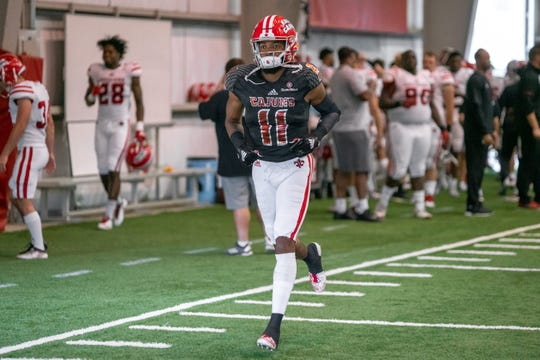 UL's Michael Jacquet runs along the sidelines as the Ragin' Cajuns football team plays their annual Spring football game against one another in the Leon Moncla trainig facility on April 13, 2019.