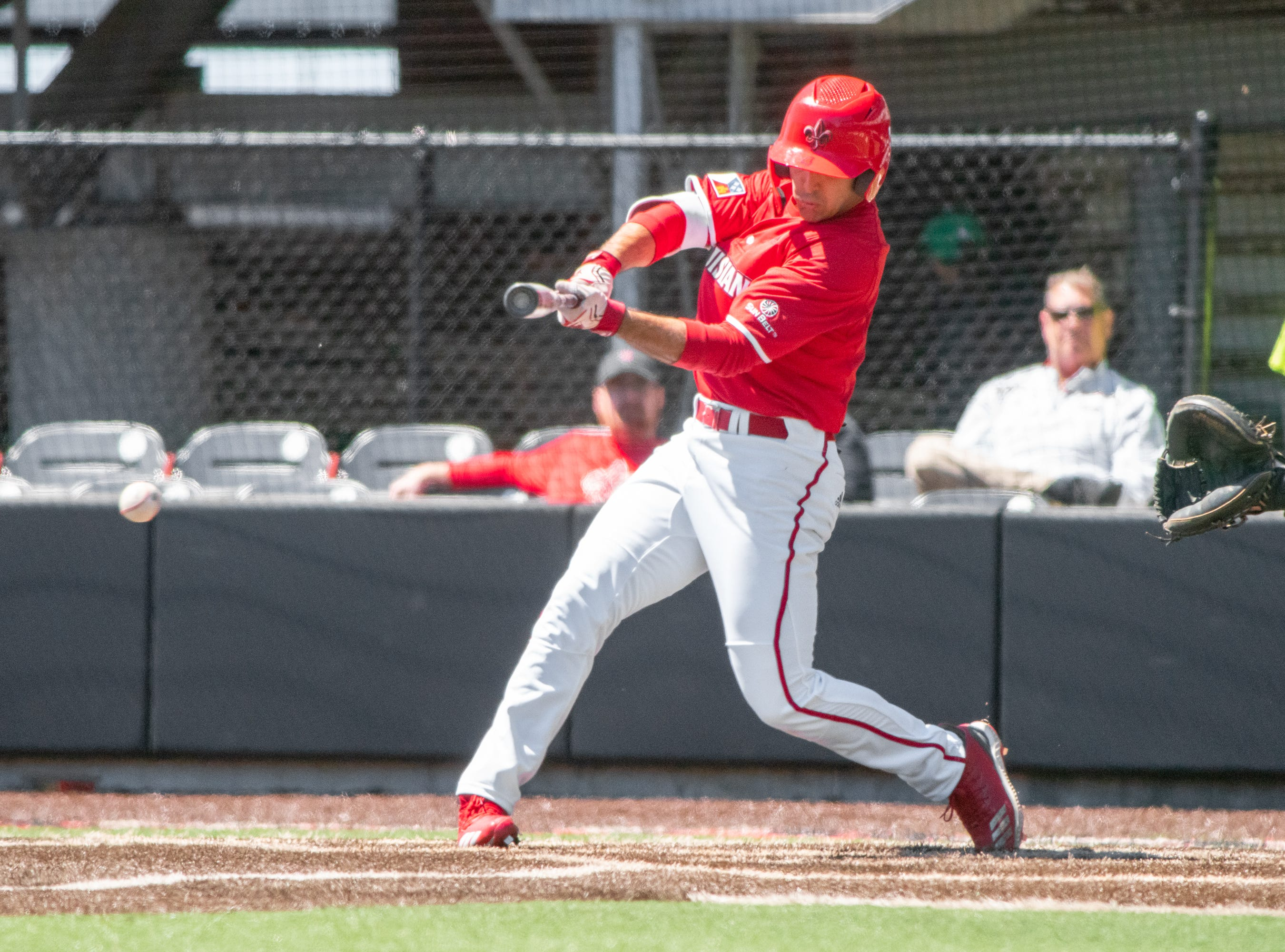 """UL's Brennan Breaux hits the incoming pitch as the Ragin' Cajuns take on the South Alabama Jaguars at M.L. """"Tigue"""" Moore Field on Sunday, April 14, 2019."""