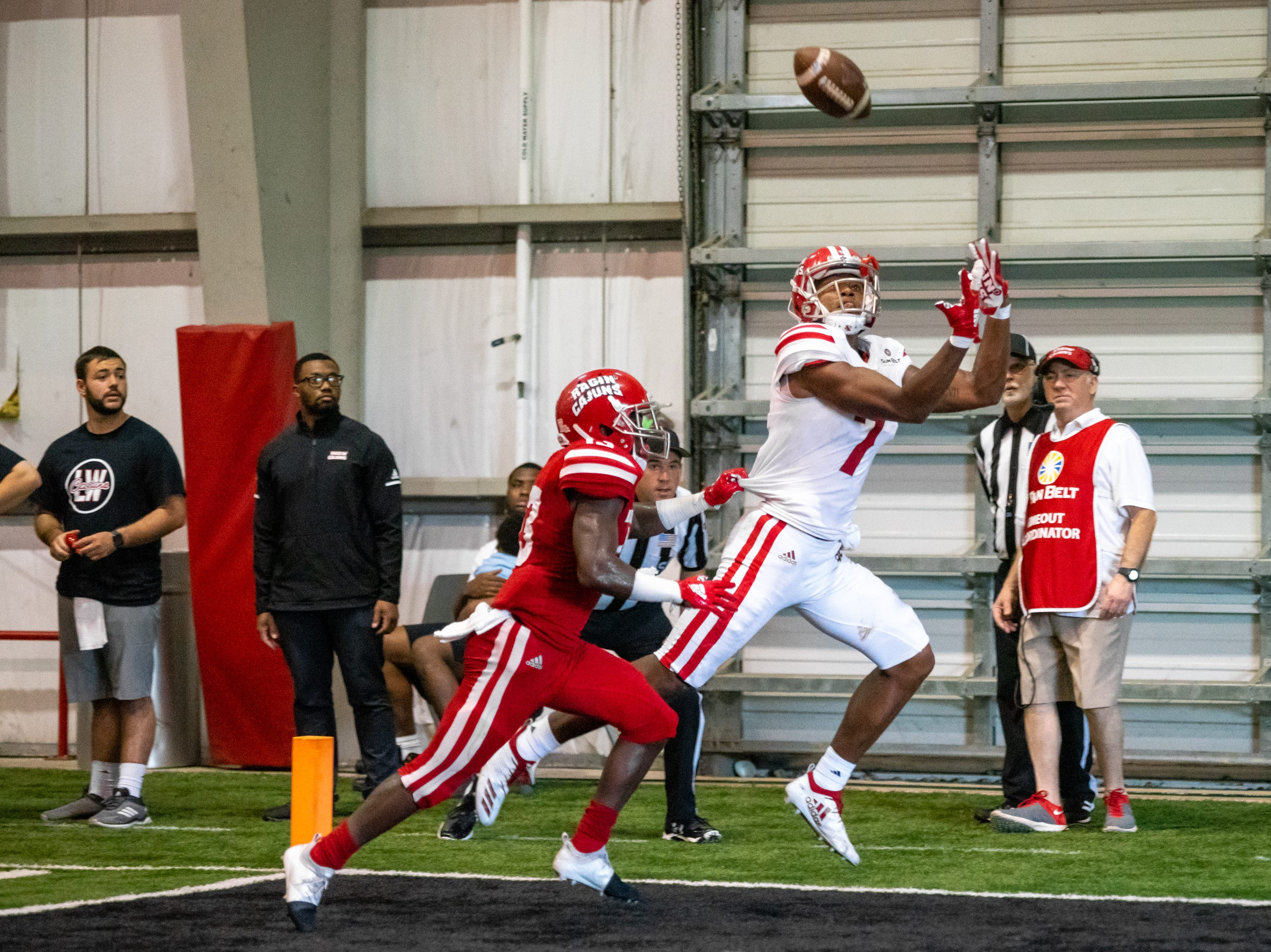 UL's Brian Smith catches the ball in the endzone to score as the Ragin' Cajuns football team plays their annual Spring football game against one another in the Leon Moncla trainig facility on April 13, 2019.