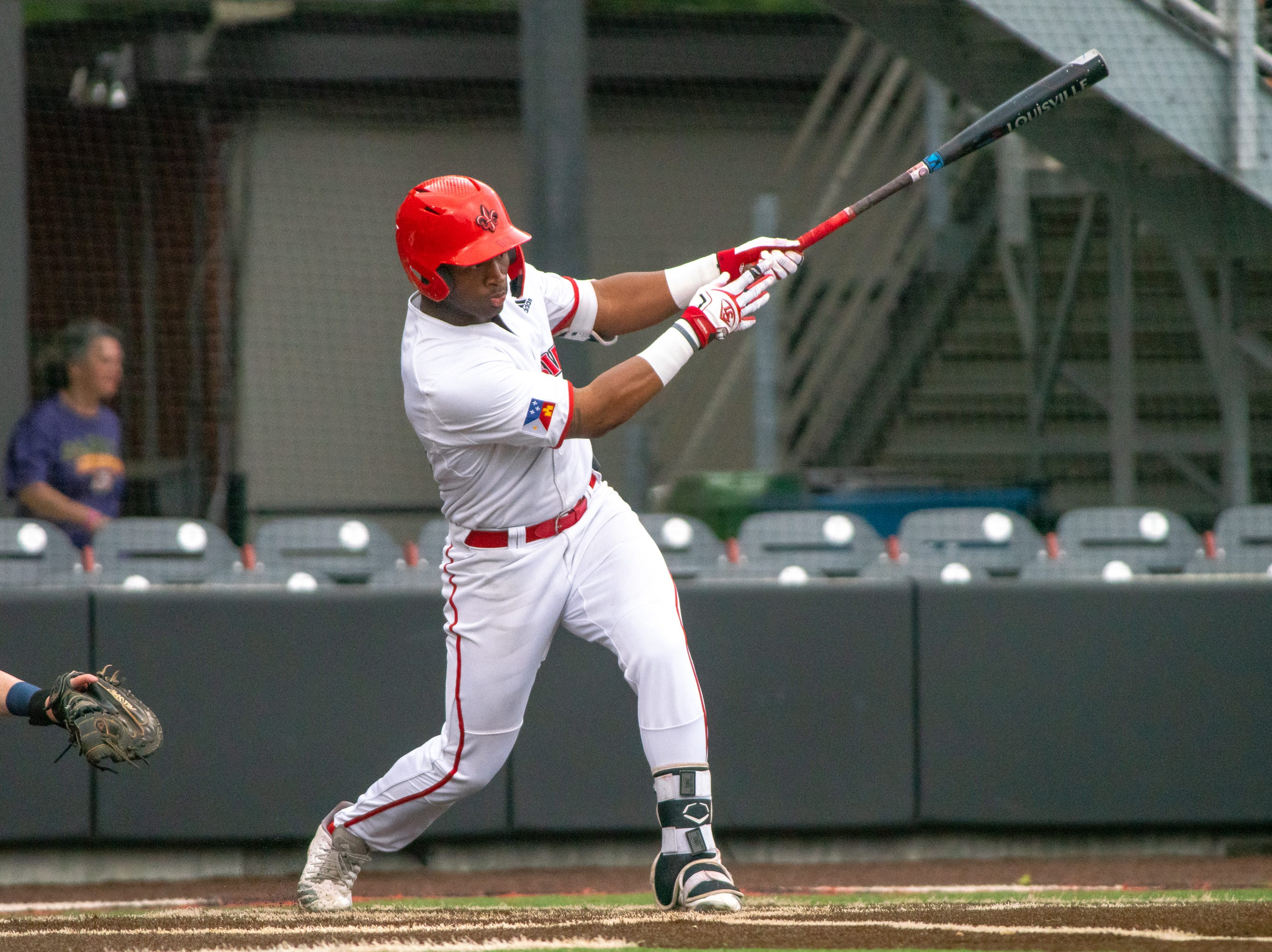"""UL's Tremaine Spears hits the ball as the Ragin' Cajuns take on the South Alabama Jaguars at M.L. """"Tigue"""" Moore Field on Saturday, April 13, 2019."""