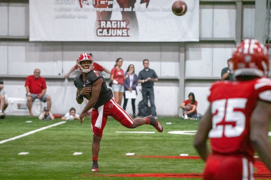 UL's quarterback Levi Lewis throws a pass as the Ragin' Cajuns football team plays their annual Spring football game against one another in the Leon Moncla trainig facility on April 13, 2019.