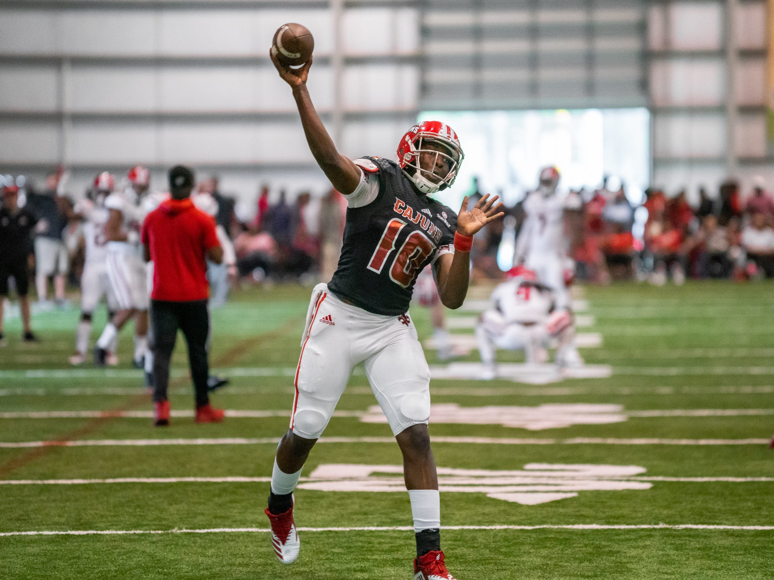 UL's quarterback Clifton McDowell practices his throw as the Ragin' Cajuns football team plays their annual Spring football game against one another in the Leon Moncla trainig facility on April 13, 2019.