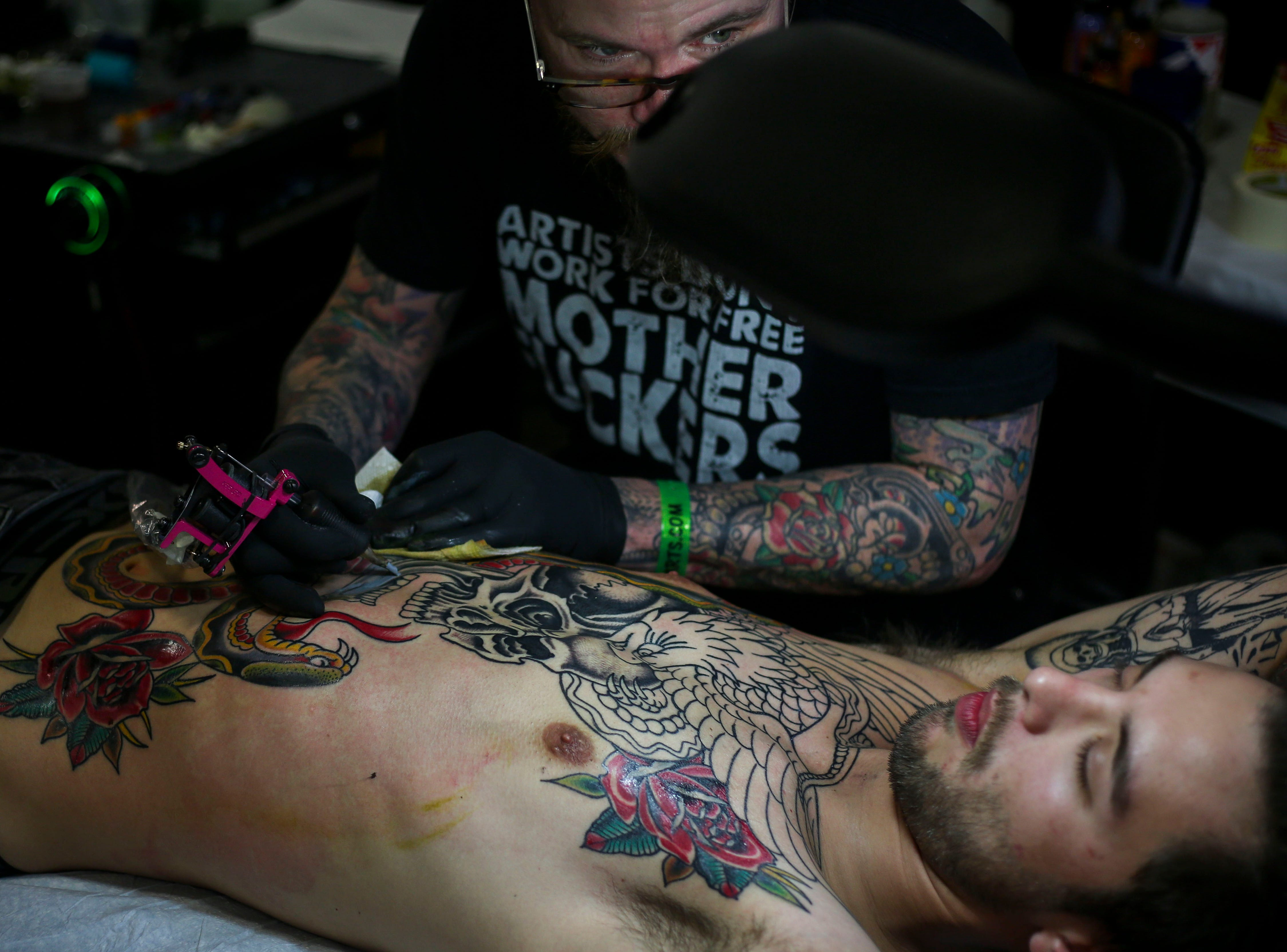 Brado Revell, Love and Devotion Historic Tattoo, tattoos Tyler Rado, from Elizabethtown, during the 8th Annual Louisville Tattoo Arts Convention put on by Villain Arts at the Kentucky Expo Center in Louisville, Ky. on Saturday, April 13, 2019.