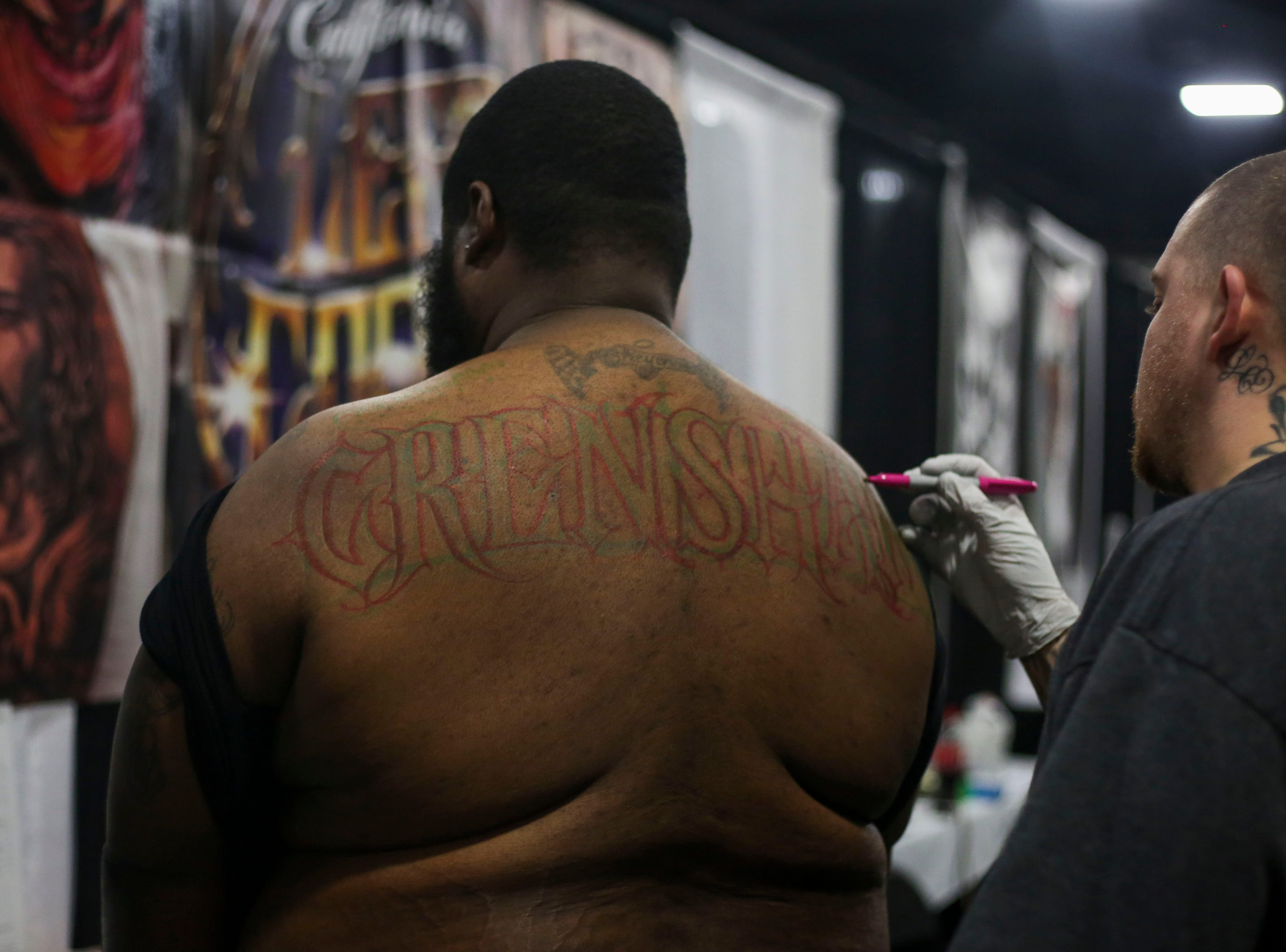 Case One sketches a tattoo on Moss during the 8th Annual Louisville Tattoo Arts Convention put on by Villain Arts at the Kentucky Expo Center in Louisville, Ky. on Saturday, April 13, 2019.