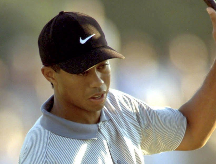 Tiger Woods pumps his fist as he birdies the 18th hole at Valhalla. The hole gave him the outright lead at the end of the day.-