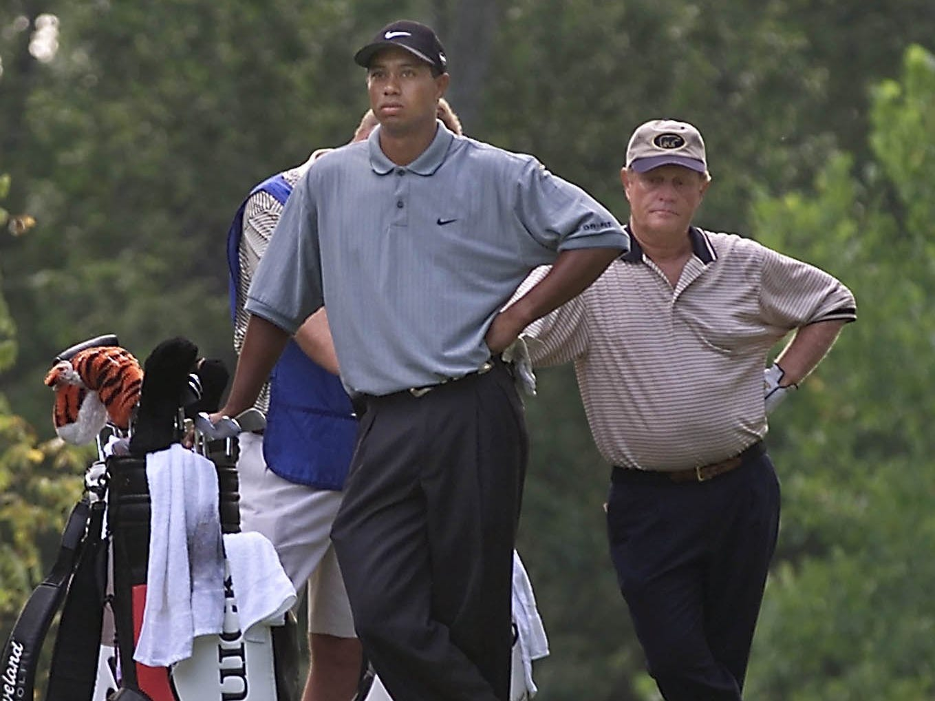 Tiger Woods who shared the early first round lead for the PGA Championship at Valhalla and Jack Nicklaus, background, waited to tee off on the second hole of the tournament.