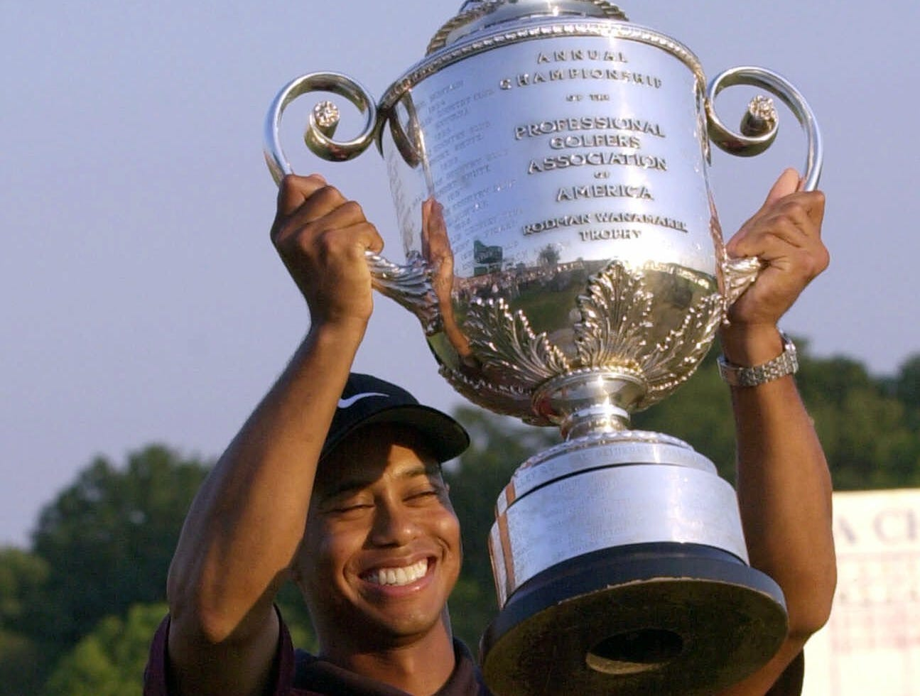 Tiger Woods holds the Wannamaker Trophy after winning the PGA Championship at the Valhalla Golf Club in Louisville, Ky., Sunday, Aug. 20, 2000