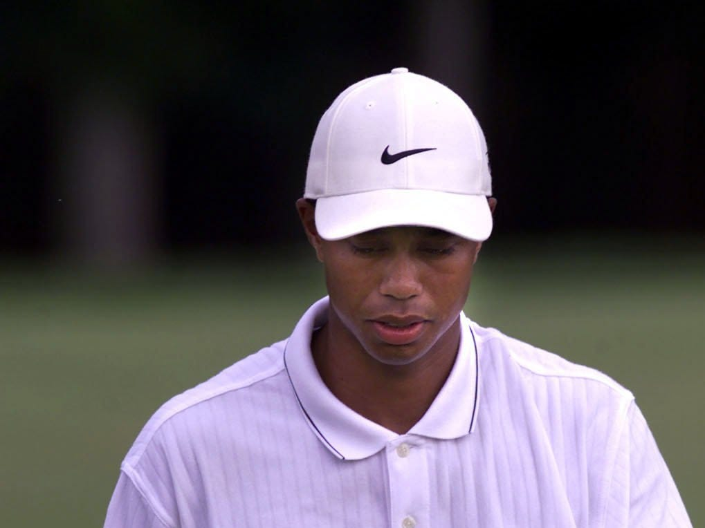 Tiger Woods is mad at himself as he walks off the 12th hole after double bogeying the hole.  8/19/00