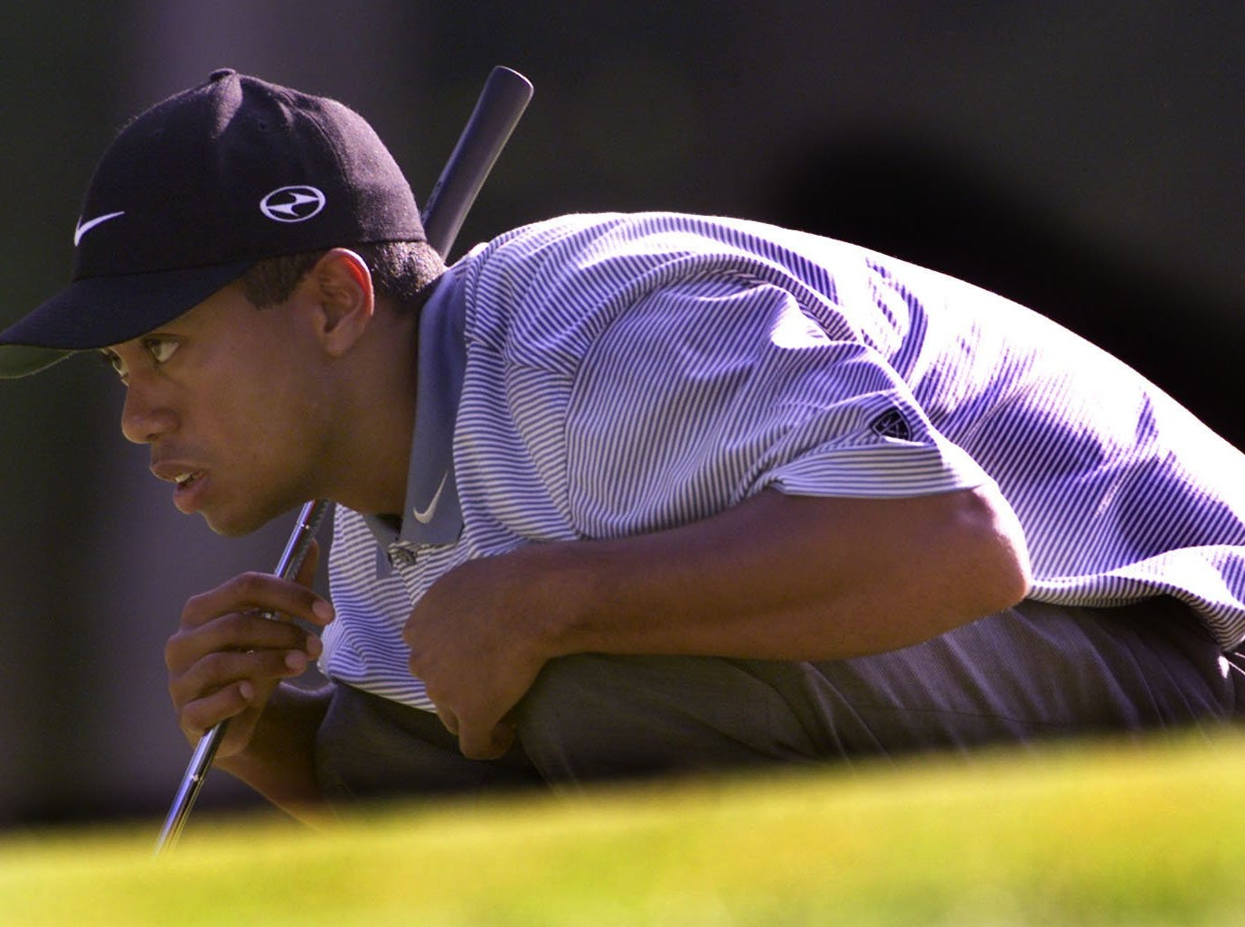 Tiger Woods concentrates on a birdie putt on the hole 13 in the second round of the PGA at Valhalla.  8/18/00