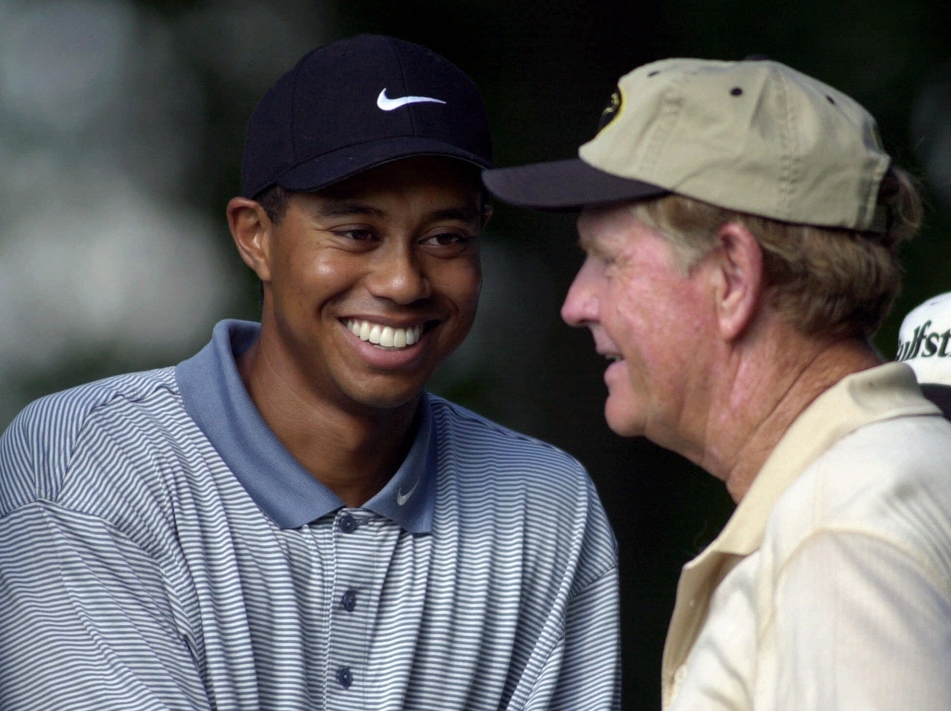 Tiger Woods, left, and Jack Nicklaus share a moment on the 12th tee during the second round of the PGA Championship, Friday, Aug. 18, 2000, at the Valhalla Golf Club in Louisville, Ky.