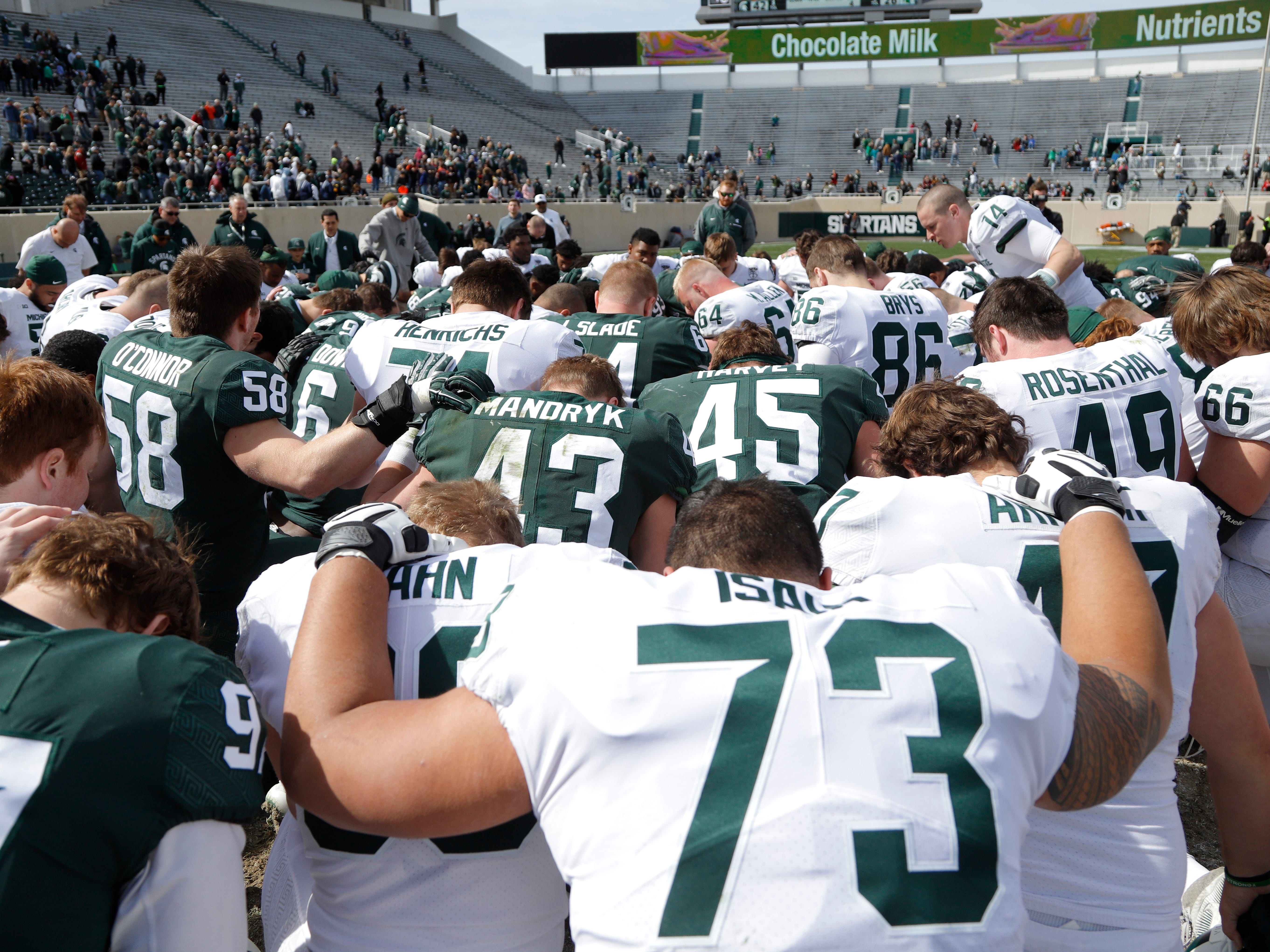 Michigan State players gather following an NCAA college football spring scrimmage game, Saturday, April 13, 2019, in East Lansing, Mich. (AP Photo/Al Goldis)