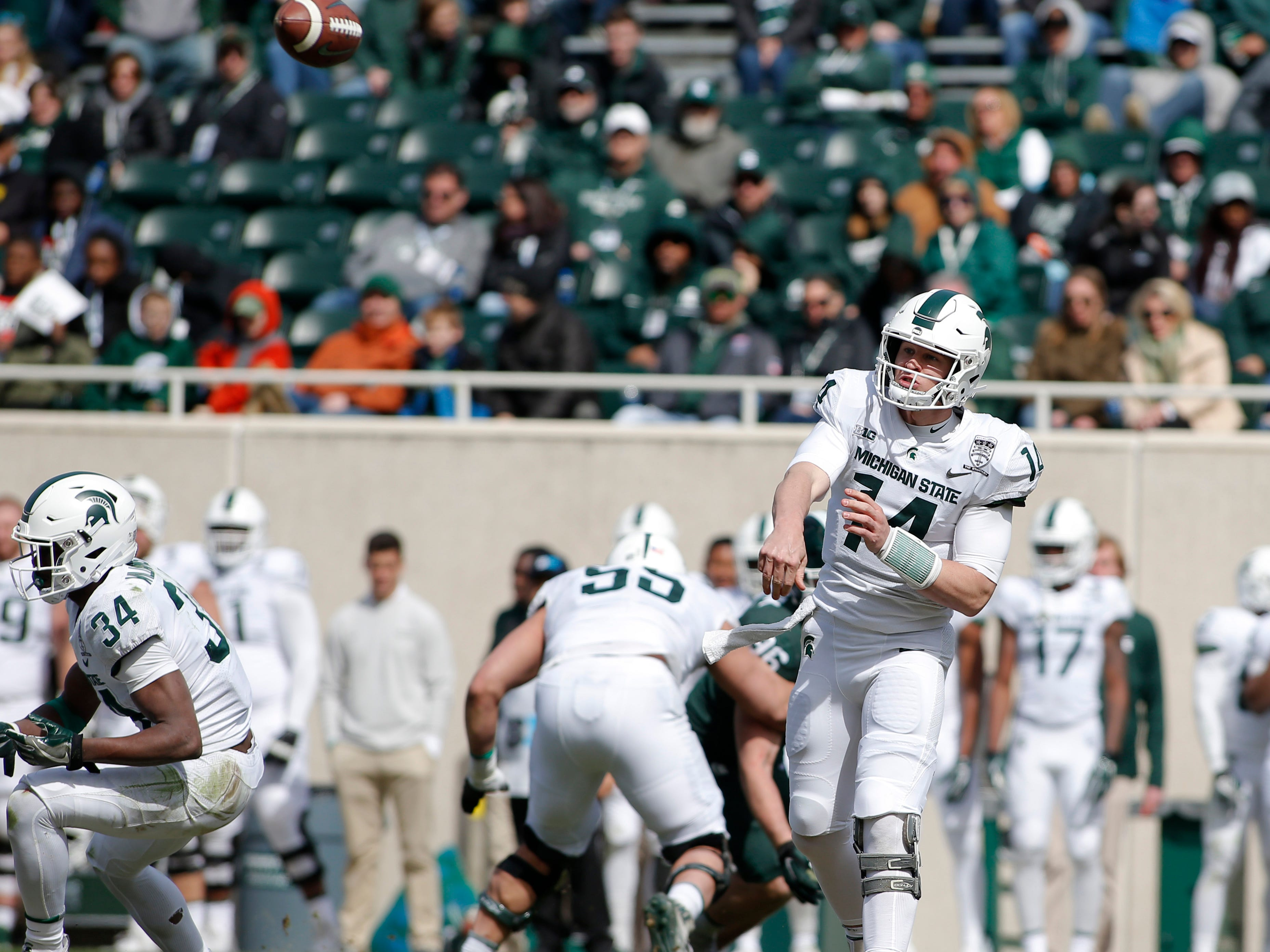 Michigan State quarterback Brian Lewerke throws a pass during a spring scrimmage, Saturday, April 13, 2019, in East Lansing.