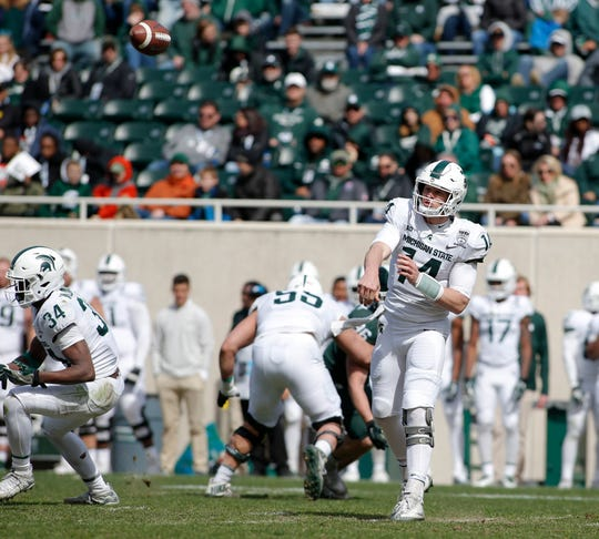 Brian Lewerke throws a pass during a spring scrimmage Saturday in East Lansing.