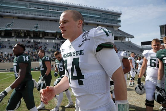 Michigan State quarterback Brian Lewerke is shown following an NCAA college football spring scrimmage game, Saturday, April 13, 2019, in East Lansing, Mich. (AP Photo/Al Goldis)