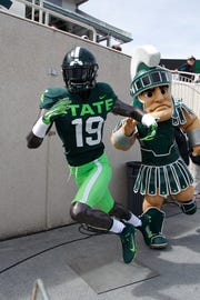 A mannequin with an alternate uniform is displayed during Michigan State's NCAA college football spring scrimmage game, Saturday, April 13, 2019, in East Lansing, Mich. (AP Photo/Al Goldis)
